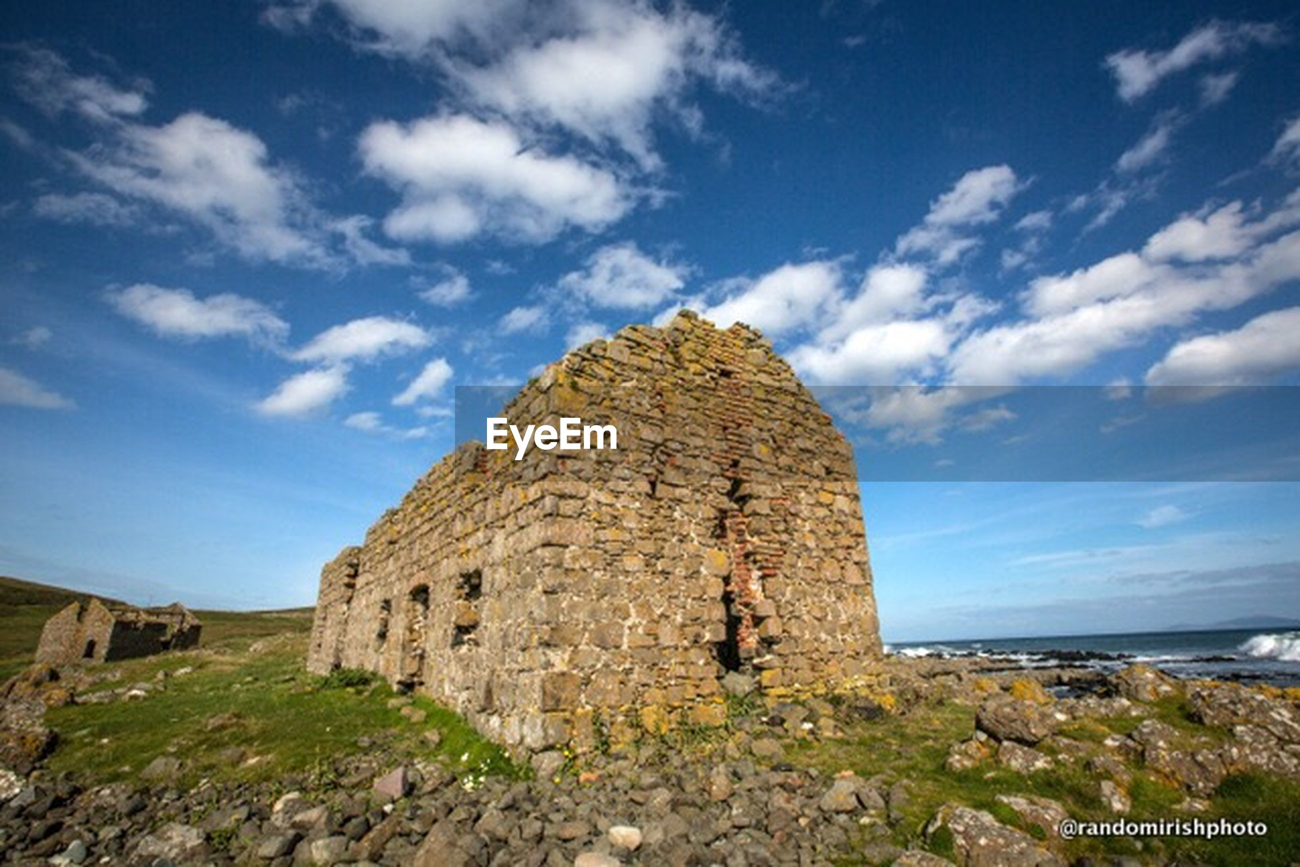 architecture, built structure, building exterior, sky, abandoned, old, damaged, cloud - sky, history, old ruin, sea, horizon over water, cloud, the past, blue, run-down, deterioration, day, obsolete, castle