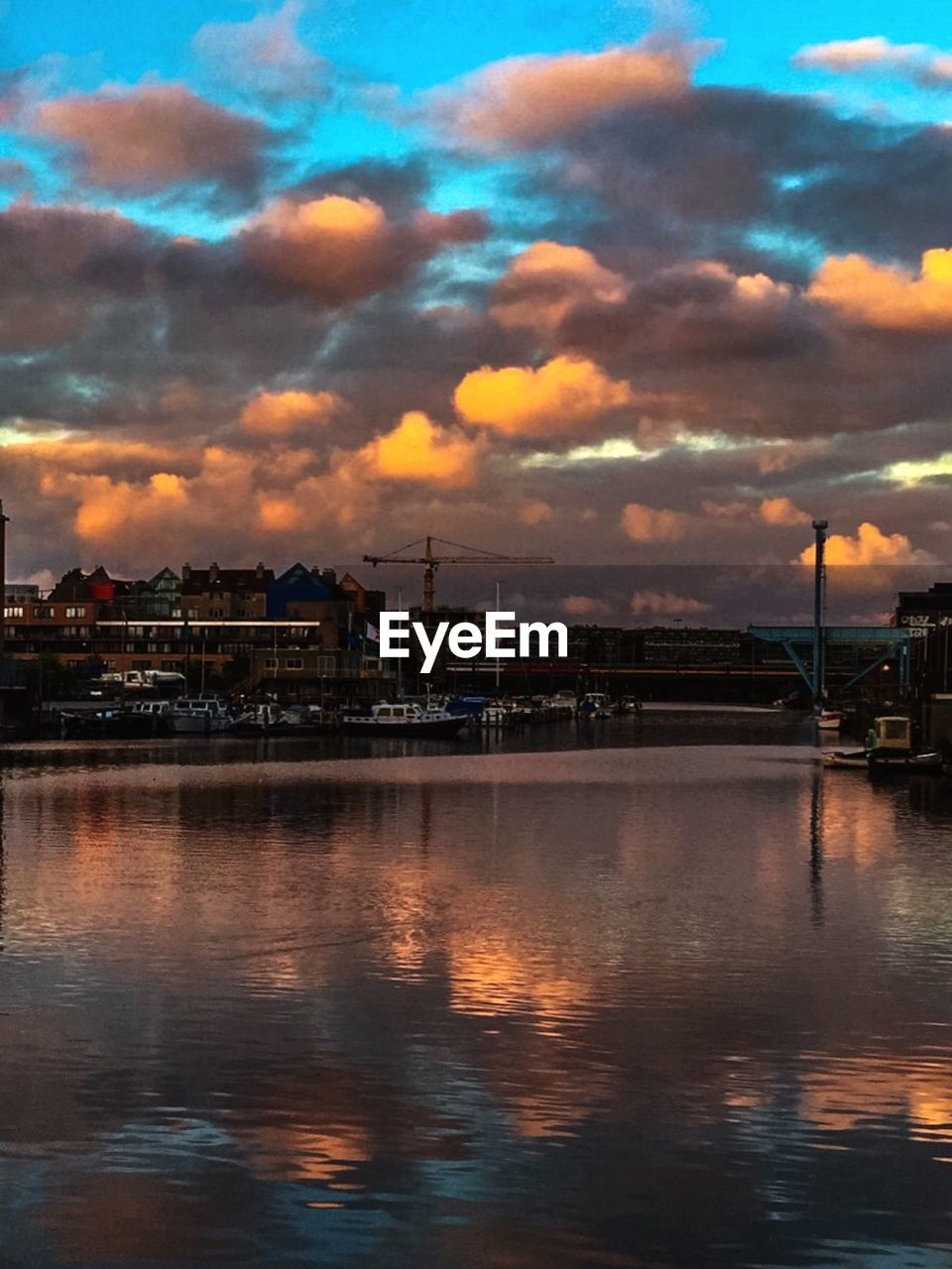 sky, cloud - sky, architecture, built structure, building exterior, water, sunset, no people, waterfront, river, reflection, outdoors, city, nature, day, beauty in nature