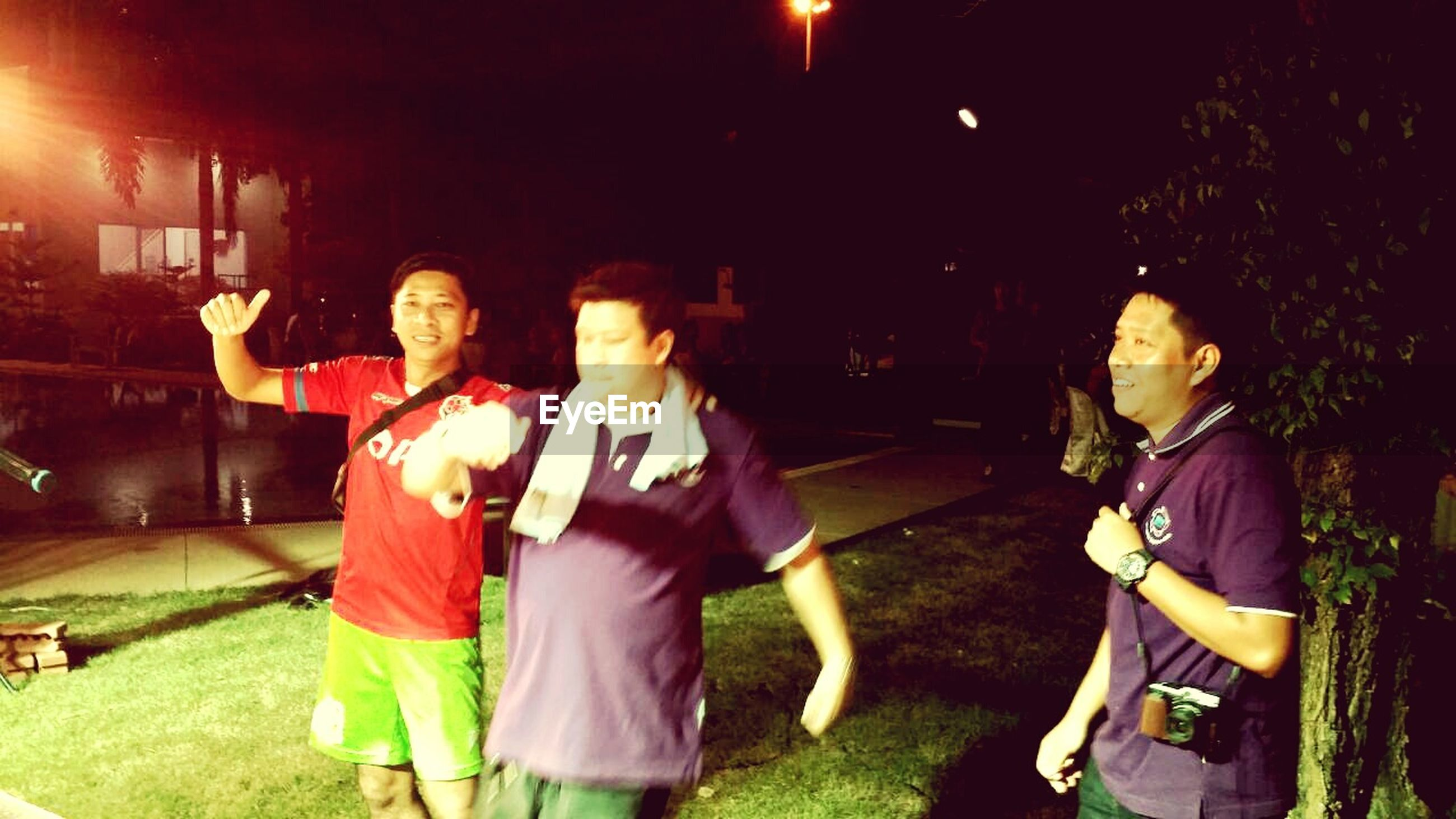 night, lifestyles, illuminated, casual clothing, leisure activity, togetherness, full length, standing, celebration, enjoyment, fun, person, men, bonding, front view, boys, three quarter length, happiness