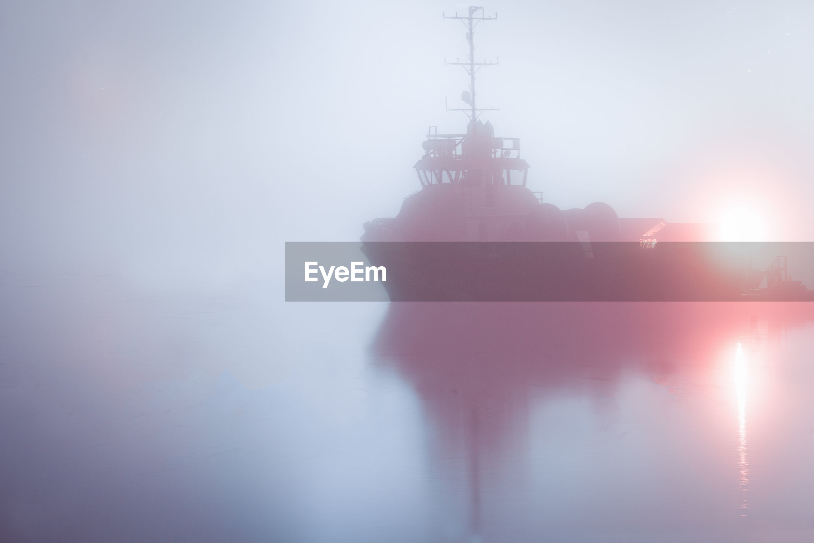LOW ANGLE VIEW OF SILHOUETTE CRANE IN FOGGY WEATHER