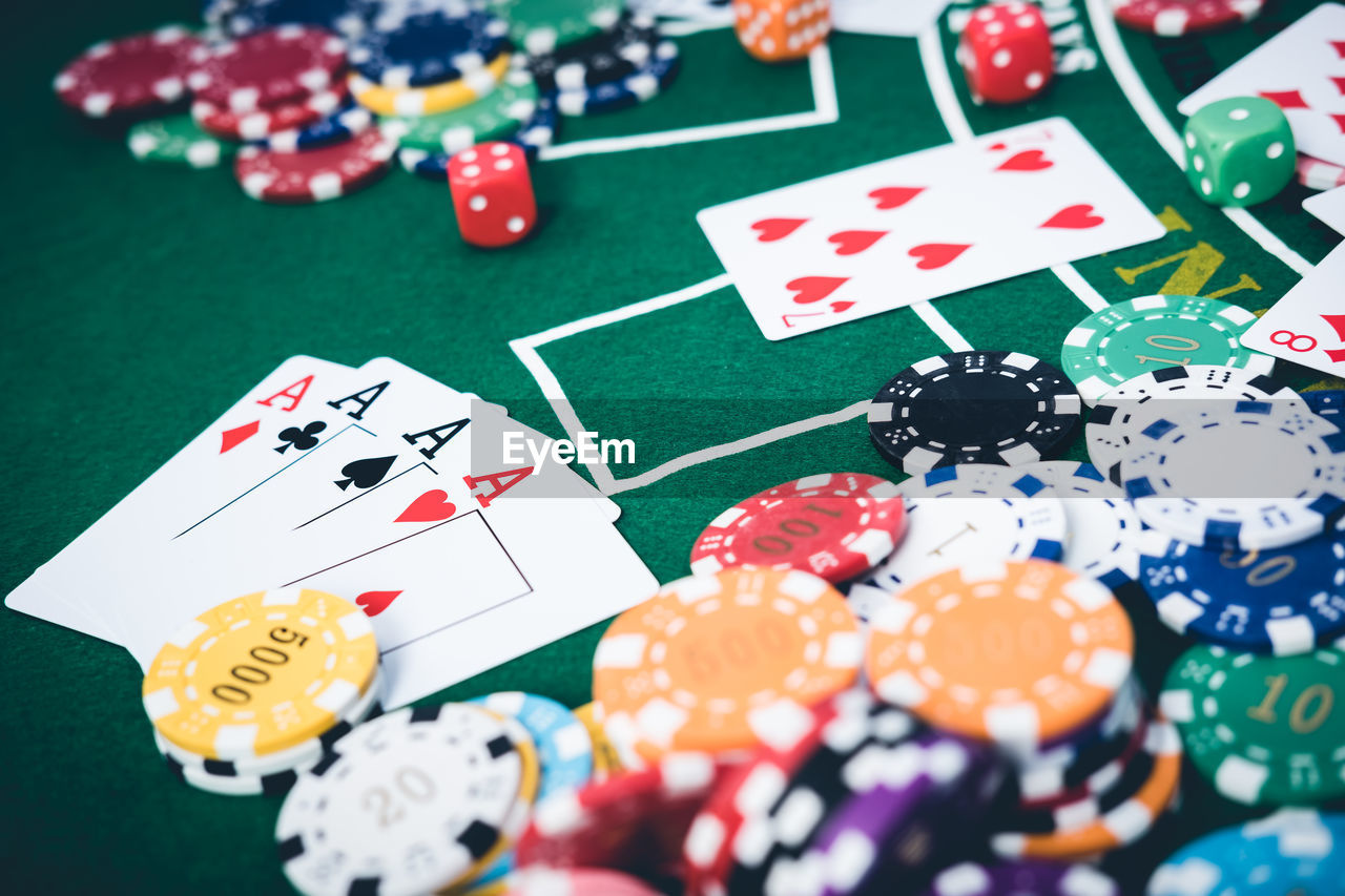High Angle View Of Gambling Chips And Cards On Table