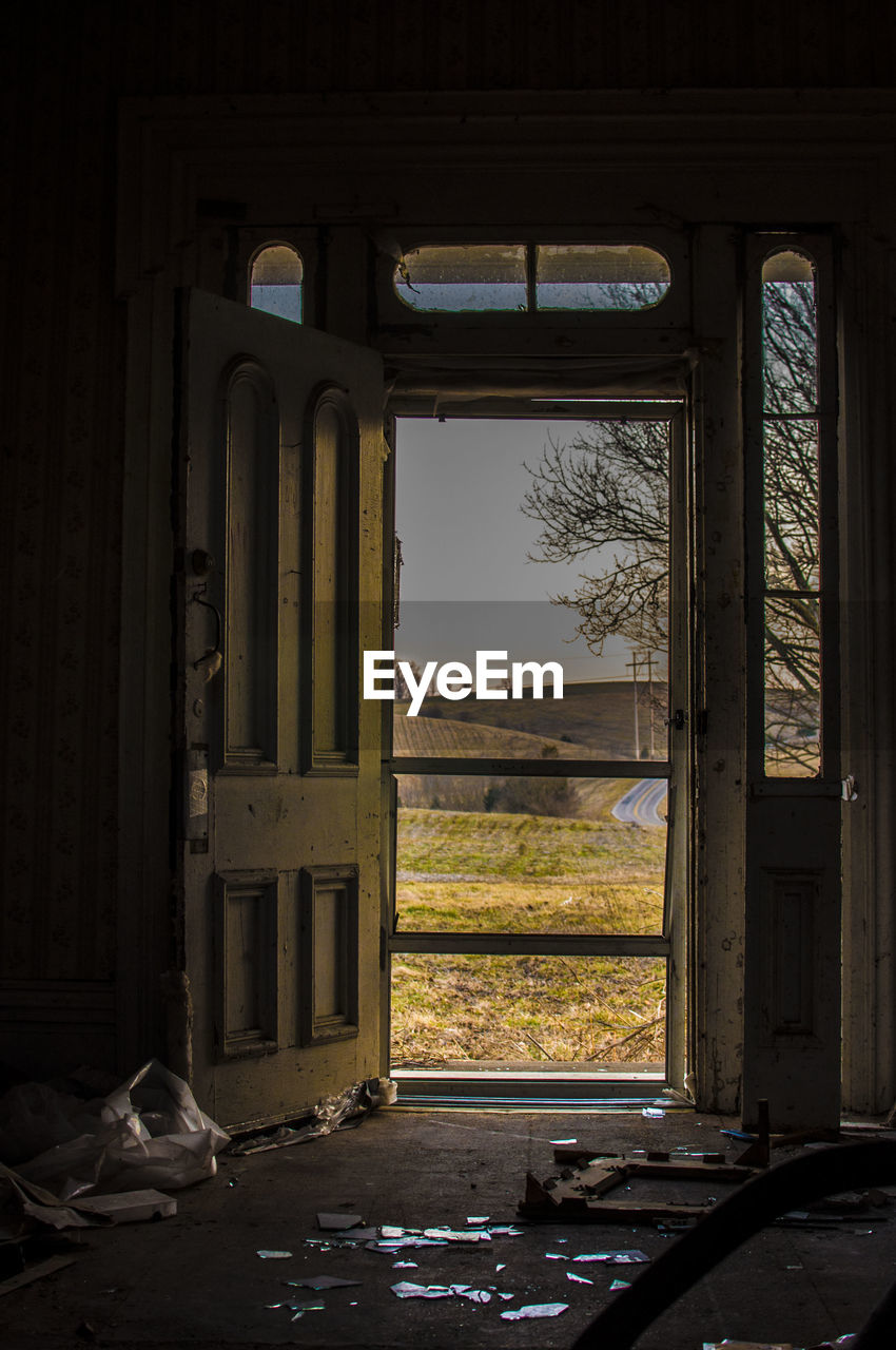 window, architecture, no people, indoors, abandoned, built structure, day, damaged, building, nature, entrance, open, obsolete, glass - material, old, door, broken, transparent, run-down, messy, ruined