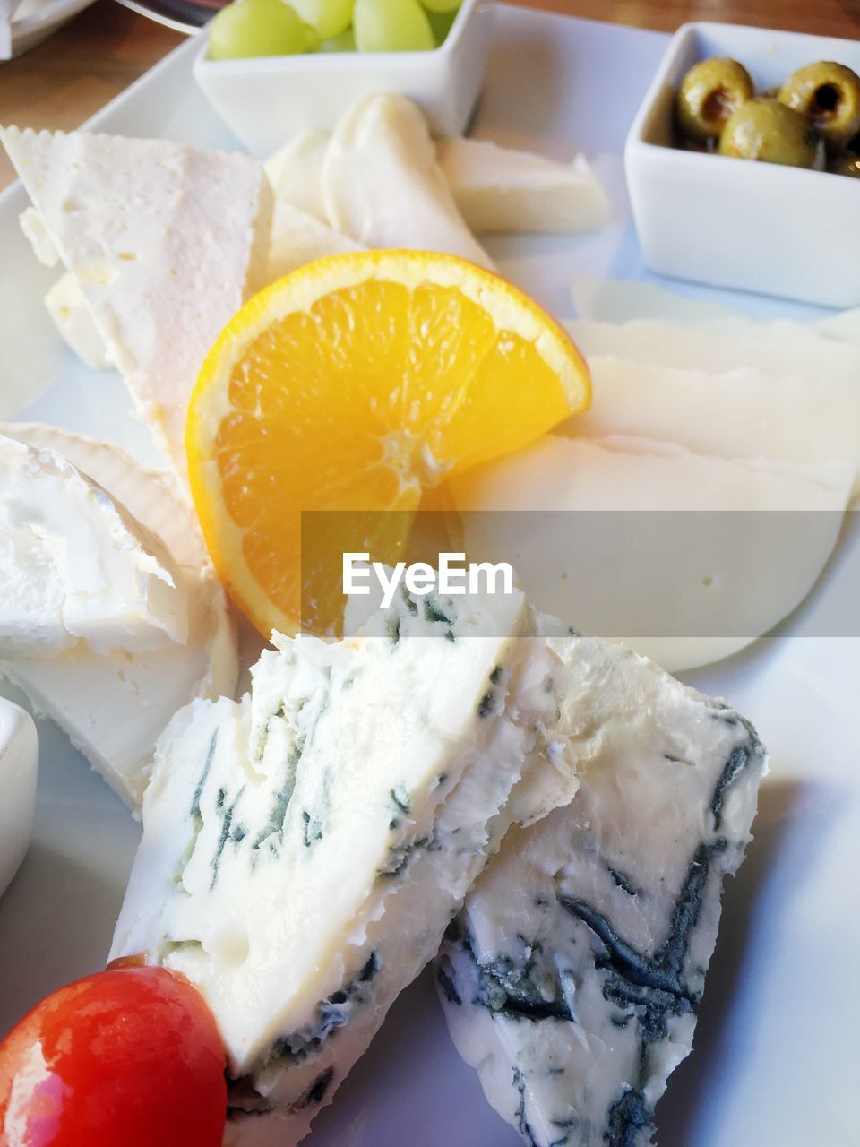 High angle view of cheese in plate on table at home