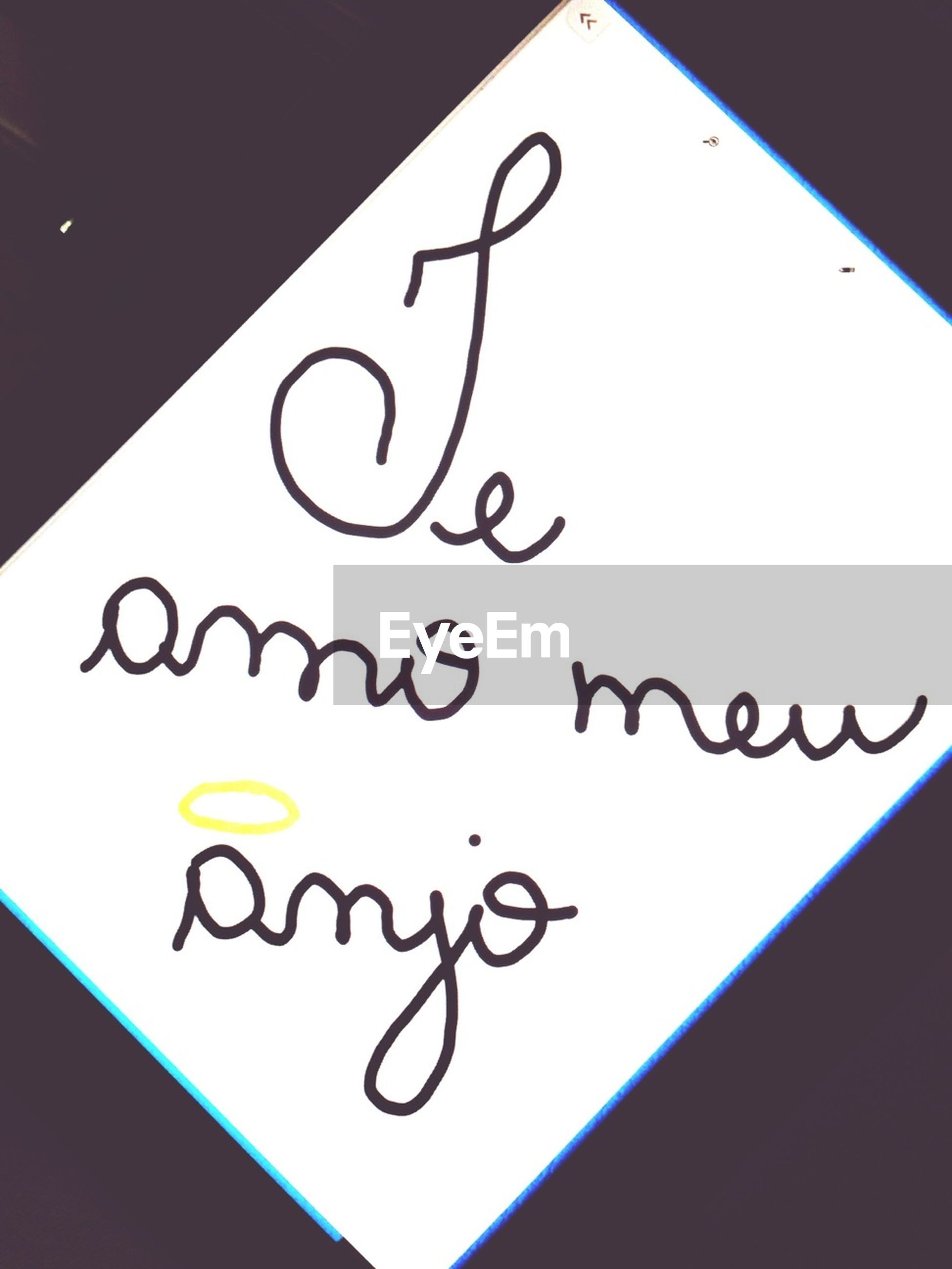 text, western script, communication, indoors, paper, close-up, capital letter, message, information, no people, non-western script, handwriting, love, table, still life, high angle view, heart shape, selective focus, wall - building feature, number