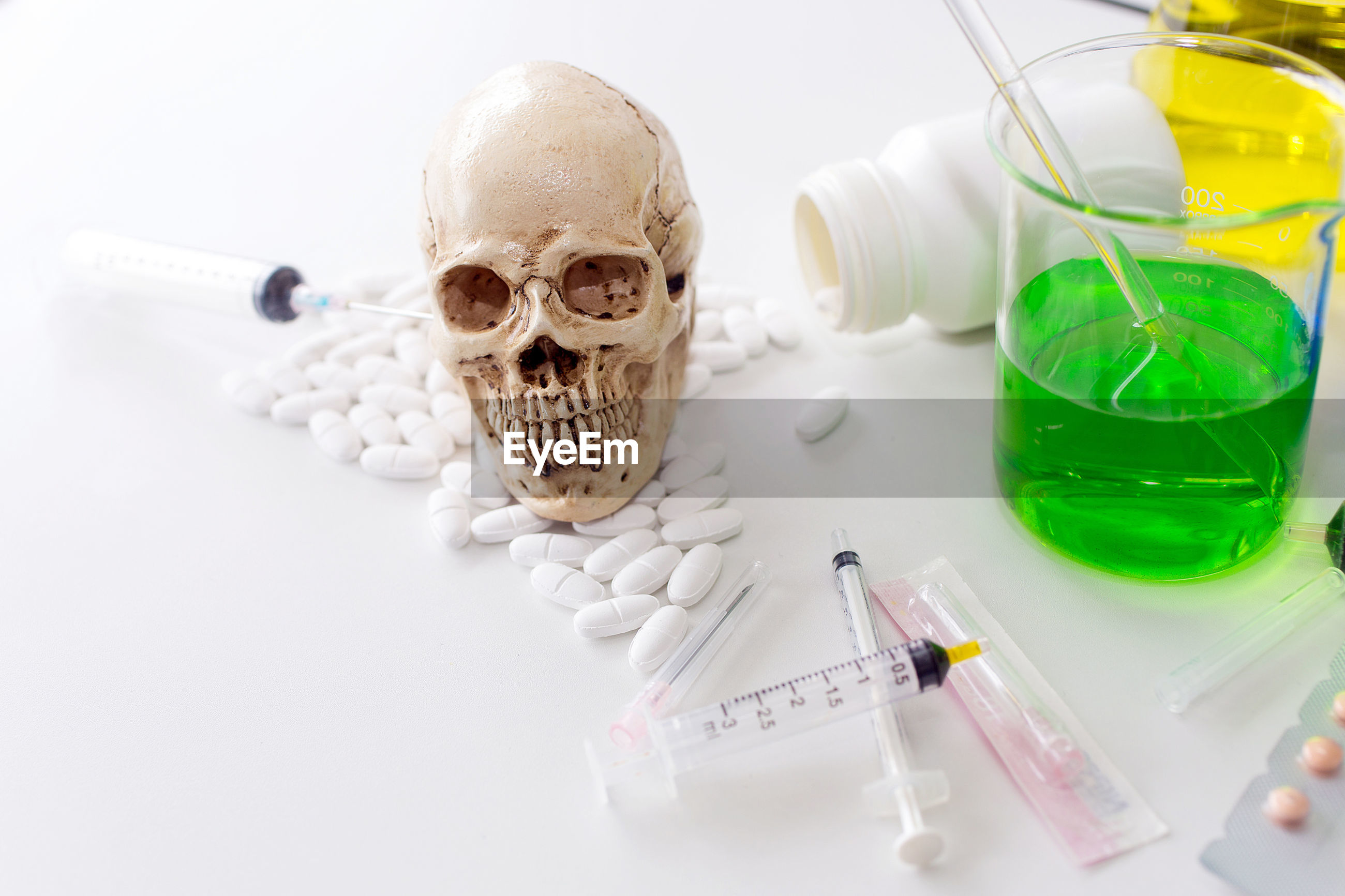 High angle view of medical equipment with skull on table