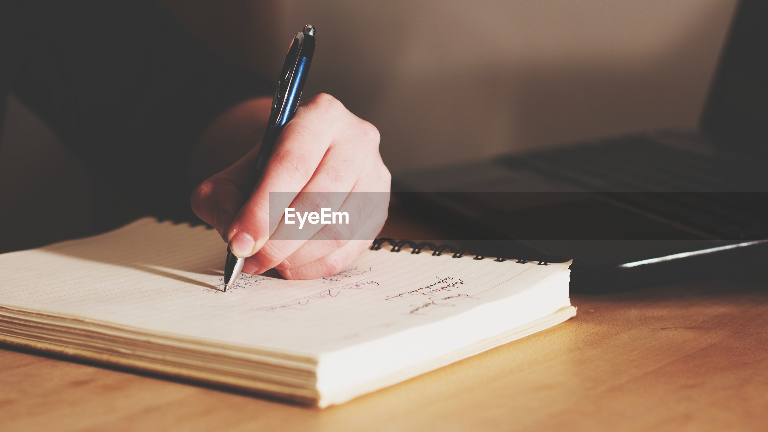human hand, writing, hand, pen, one person, book, table, human body part, paper, publication, real people, indoors, holding, selective focus, writing instrument, education, communication, unrecognizable person, adult, note pad, finger, studying