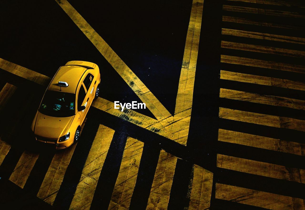 High Angle View Of Car Moving On Street At Night
