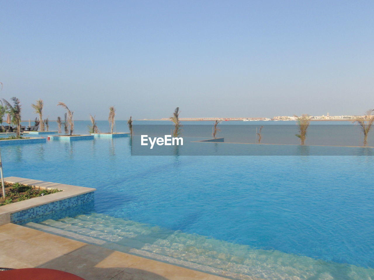 water, sky, clear sky, nature, scenics - nature, day, swimming pool, pool, sea, tranquil scene, copy space, tranquility, blue, beauty in nature, waterfront, no people, reflection, travel, outdoors