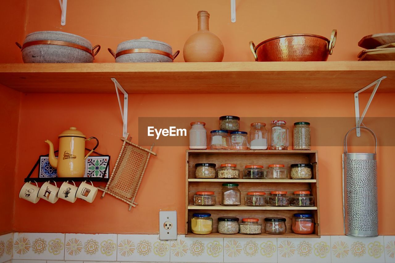 Various utensils arranged on shelves