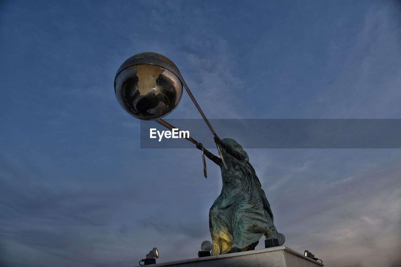 sculpture, statue, human representation, representation, art and craft, low angle view, sky, cloud - sky, no people, male likeness, creativity, nature, day, female likeness, craft, blue, outdoors, architecture, monument, angel