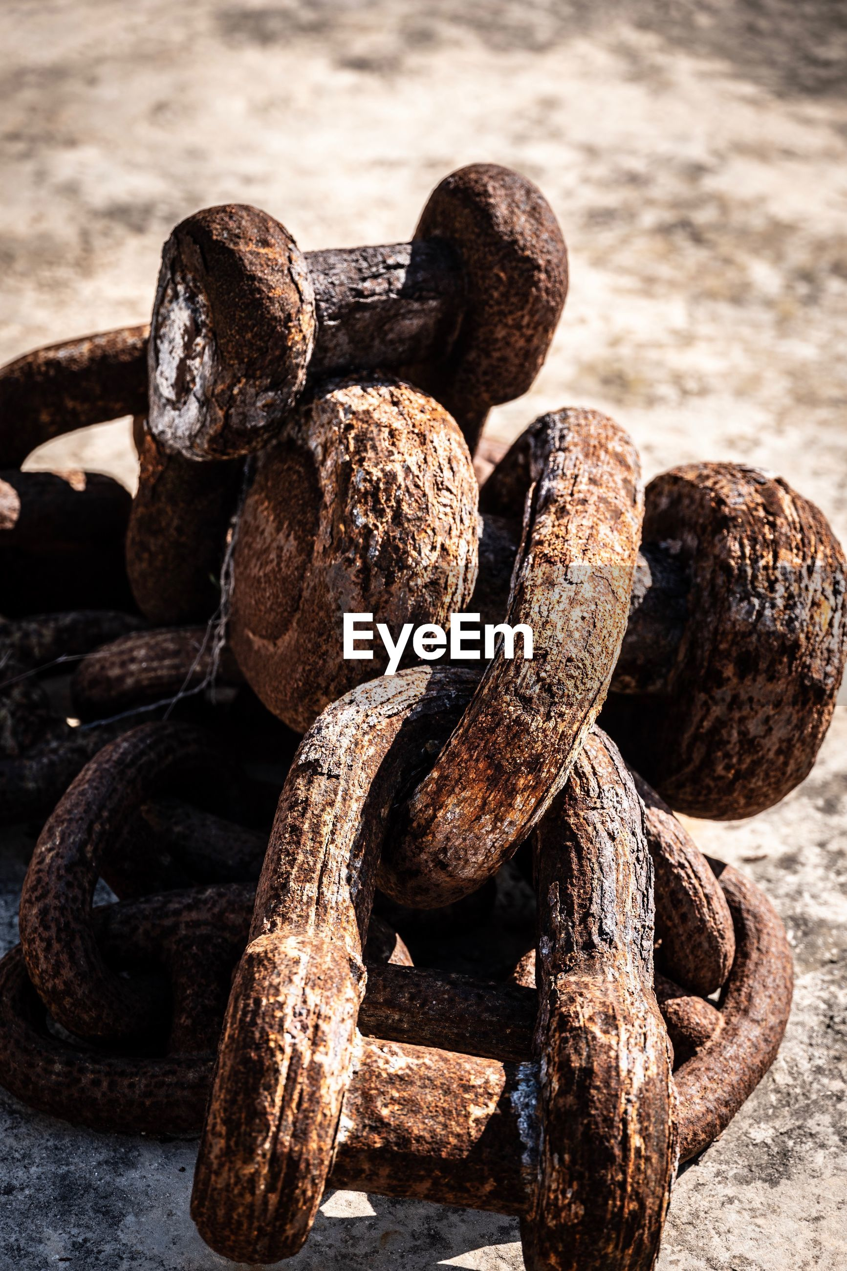 High angle view of rusty chain on land