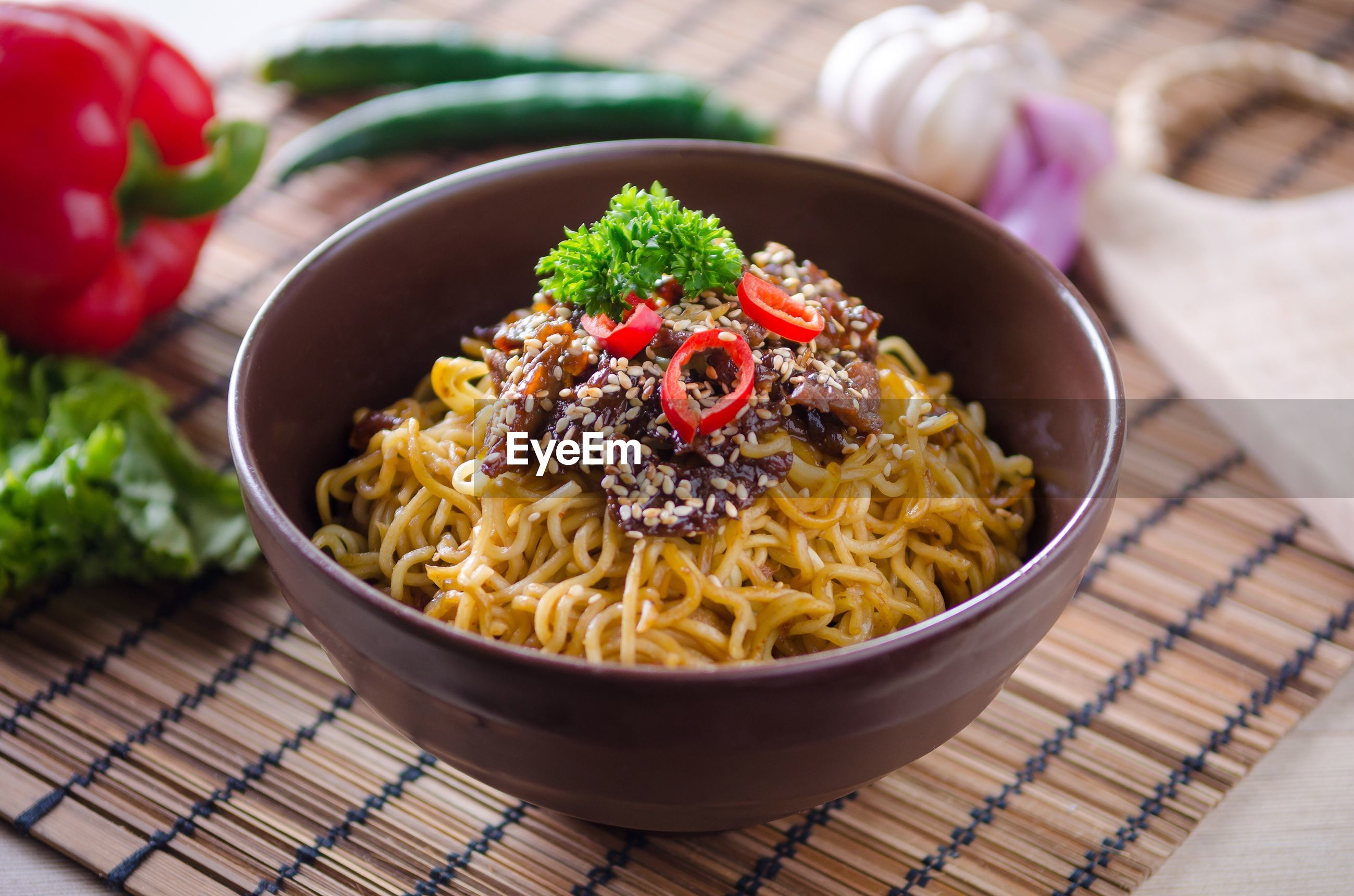 Close-up of noodles with meat in bowl on table