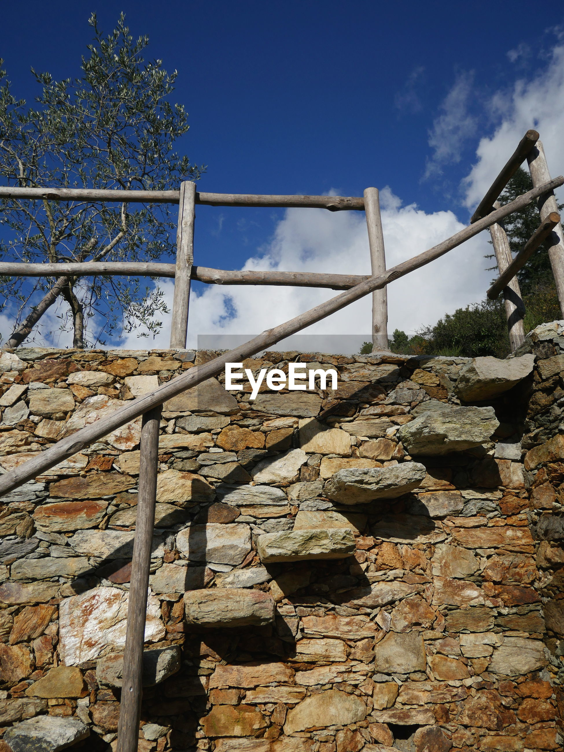 Low angle view of stone staircase against sky