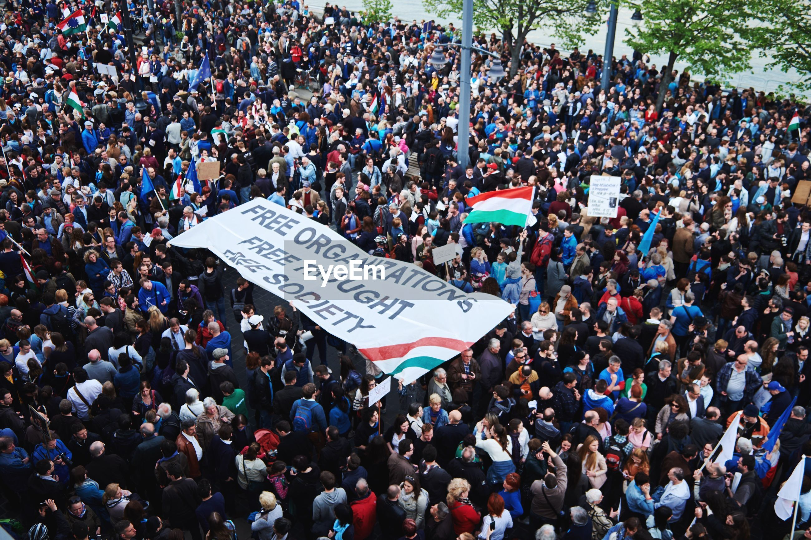 High angle view of crowd with banner during protest rally