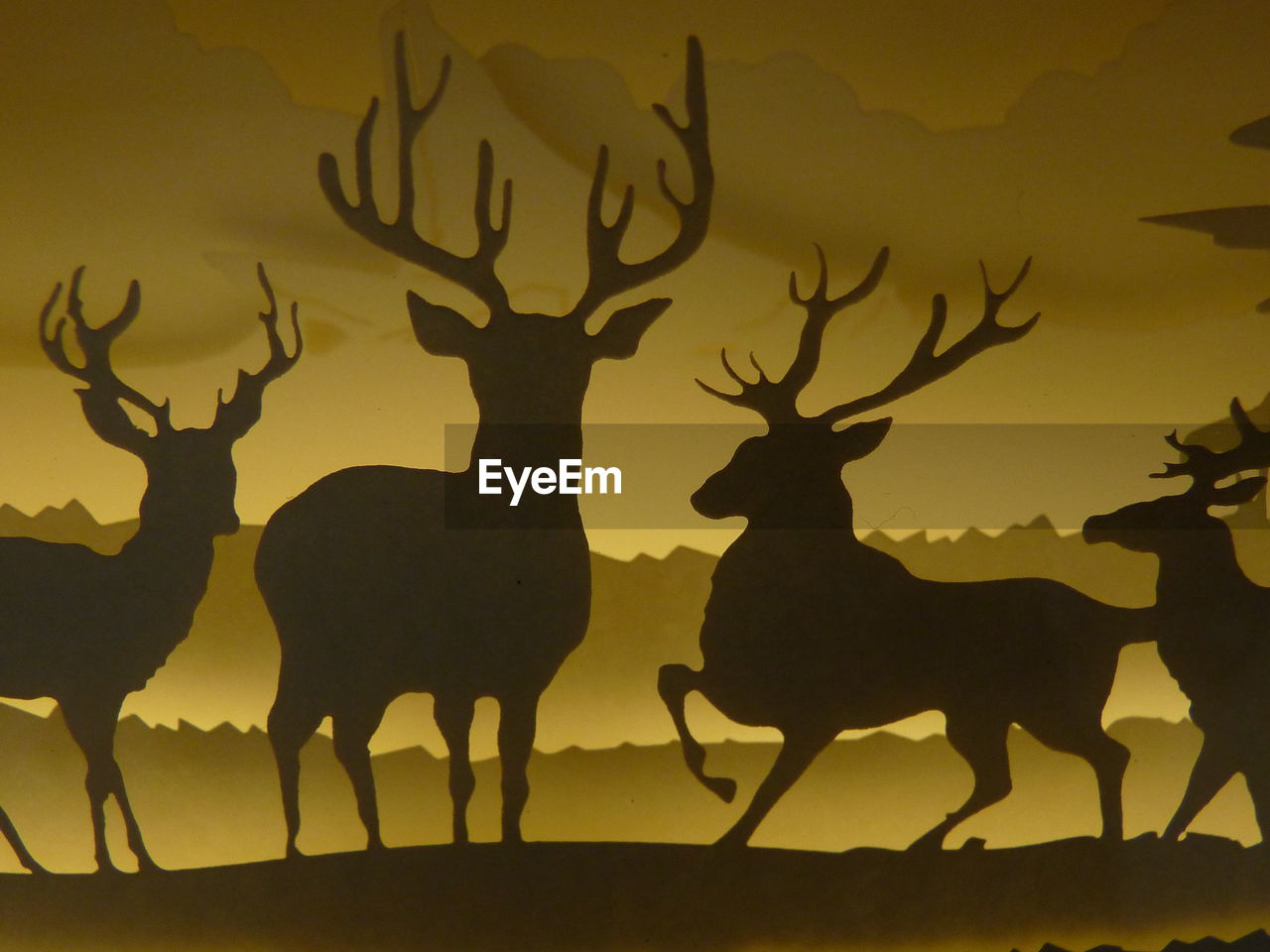 silhouette, animal representation, deer, animal themes, no people, mammal, outdoors, nature, day, sky