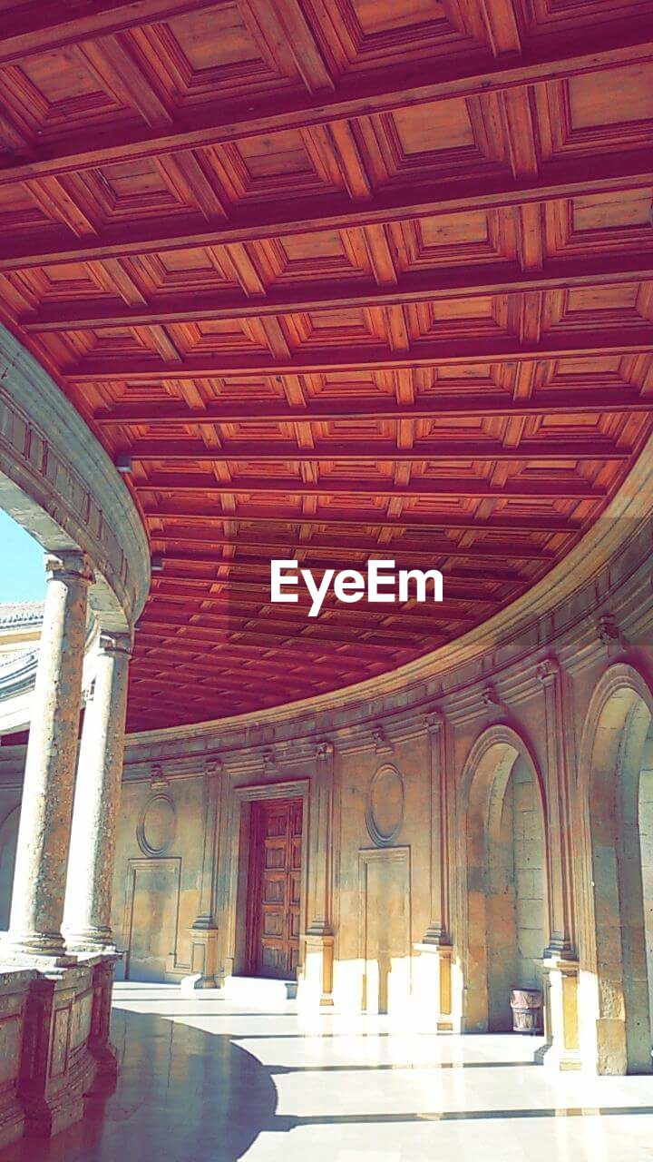 indoors, ceiling, architectural column, architecture, built structure, low angle view, day, no people