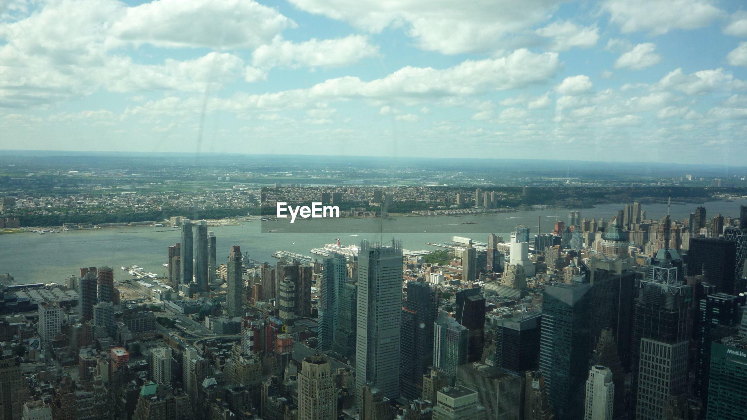 AERIAL VIEW OF MODERN BUILDINGS AGAINST SKY