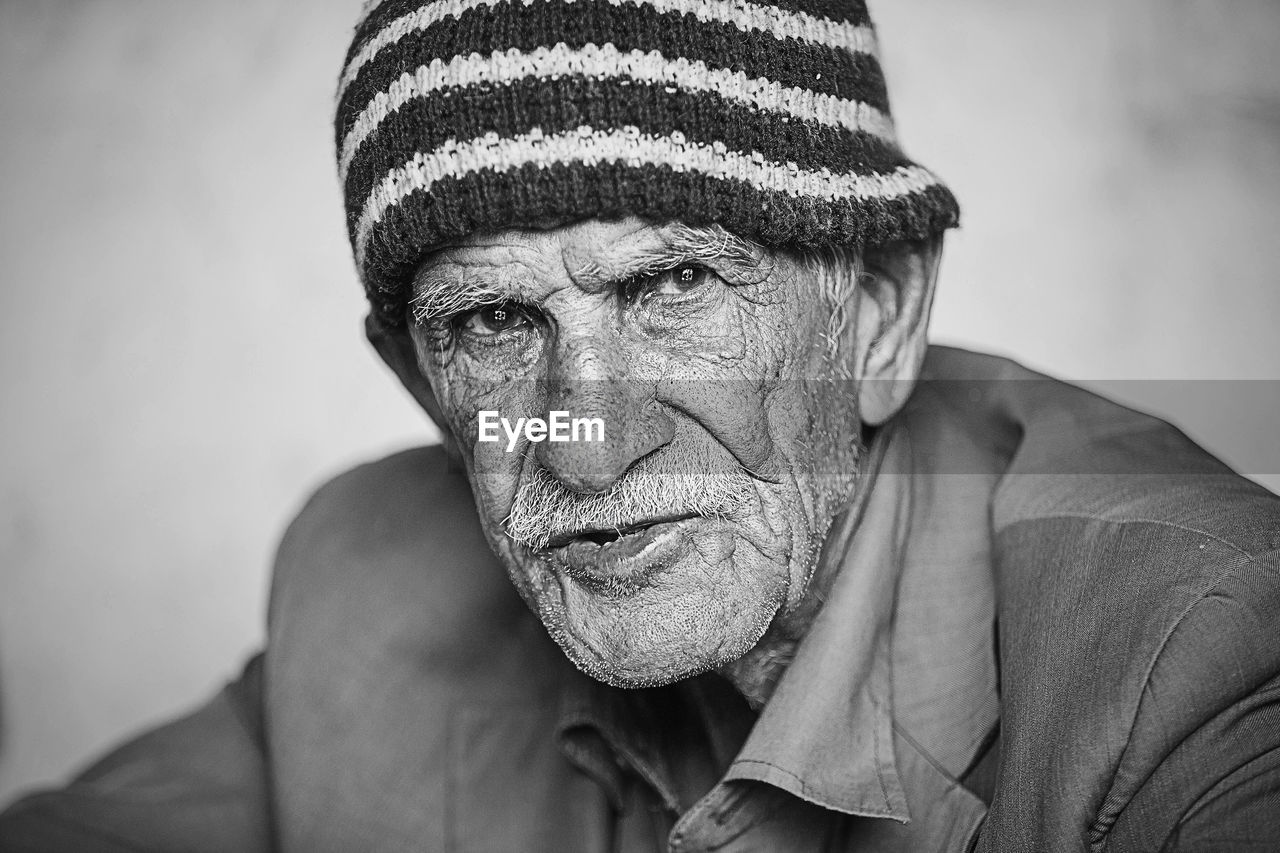Close-up portrait of senior man wearing knit hat