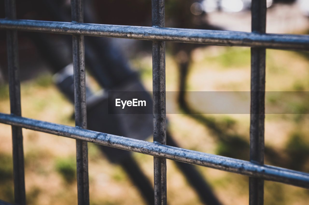 metal, focus on foreground, fence, barrier, boundary, no people, safety, security, protection, close-up, day, railing, outdoors, security bar, punishment, architecture, prison, grid, prison bars, prison cell, iron - metal, steel, wrought iron, alloy