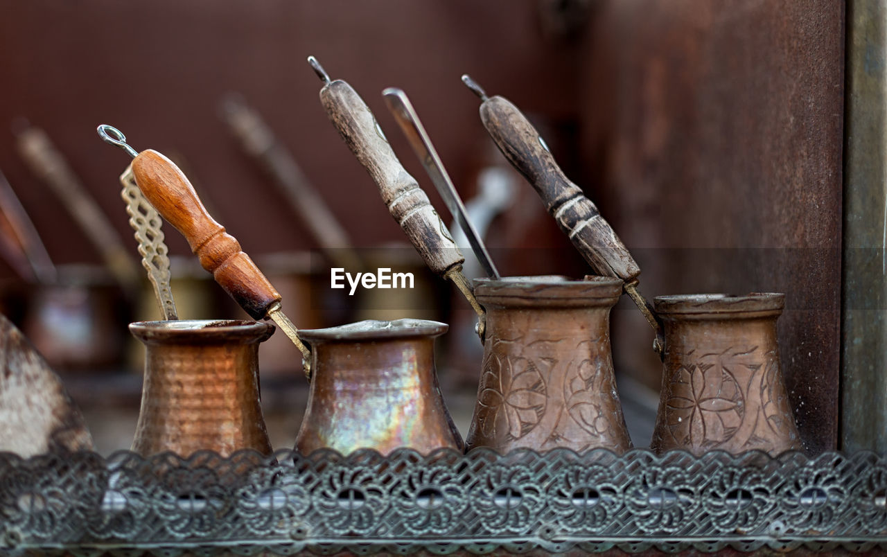 no people, close-up, still life, focus on foreground, container, brown, indoors, wood - material, day, selective focus, large group of objects, food, food and drink, table, basket, art and craft, craft, metal, group of objects, old