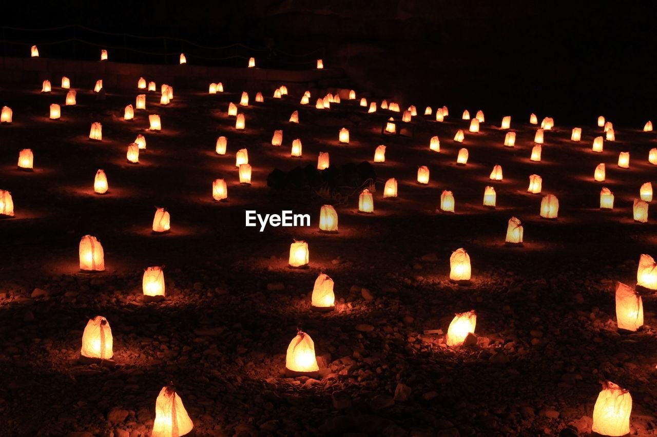 High angle view of illuminated lanterns on field at night