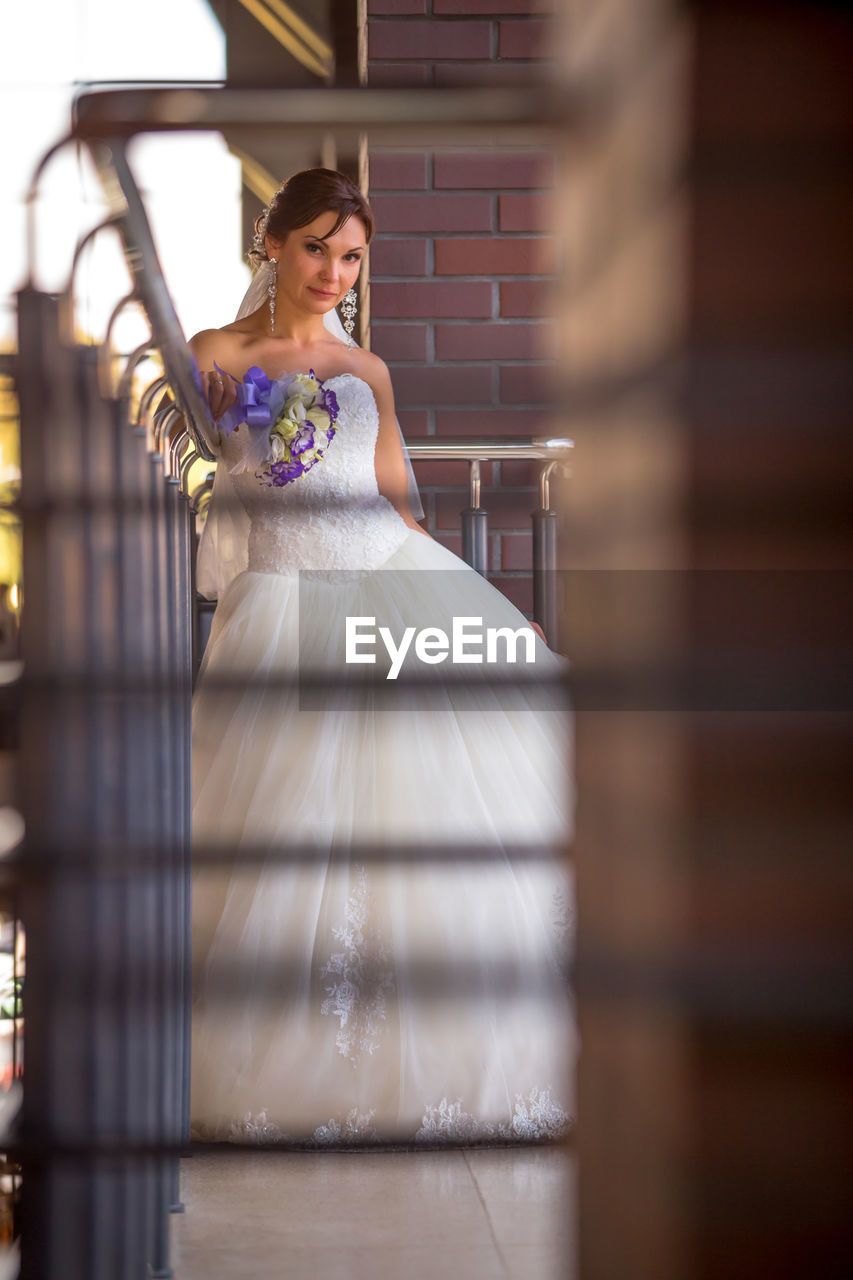 Bride standing on staircase