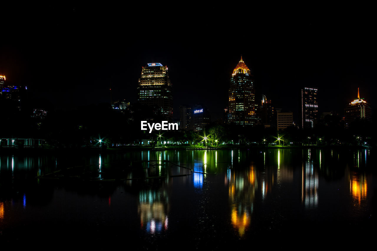 night, reflection, building exterior, illuminated, architecture, built structure, water, building, waterfront, city, sky, no people, river, nature, travel destinations, office building exterior, tall - high, skyscraper, modern, cityscape, financial district