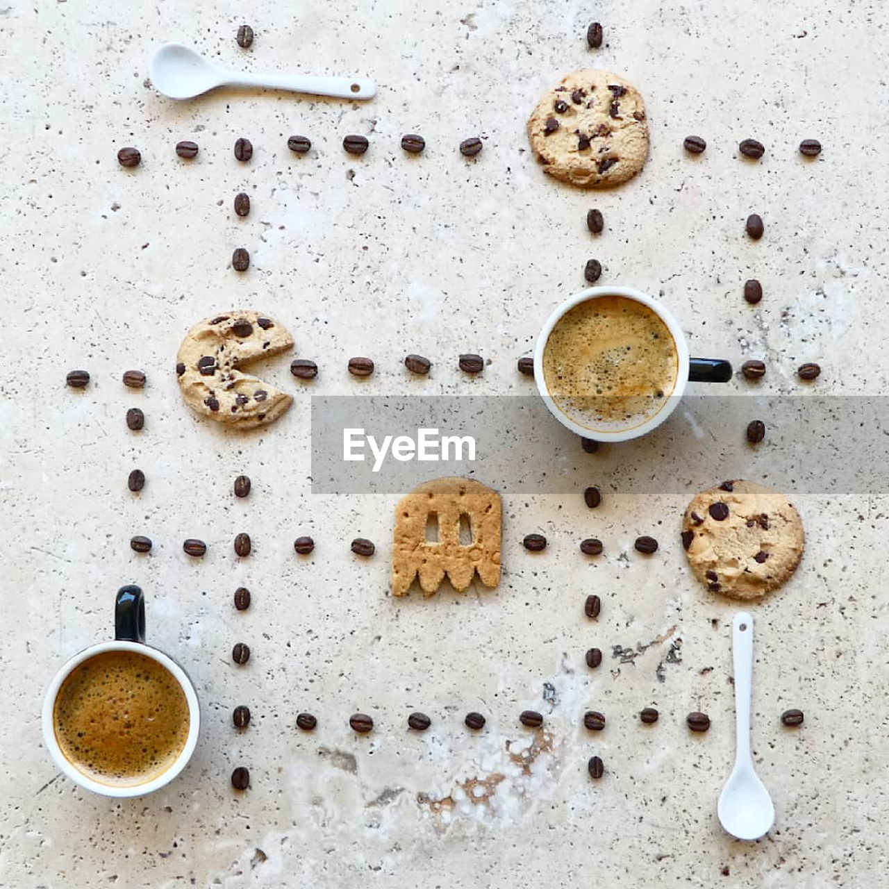 Directly Above Shot Of Coffee Cups With Beans And Cookies Arranged On Table