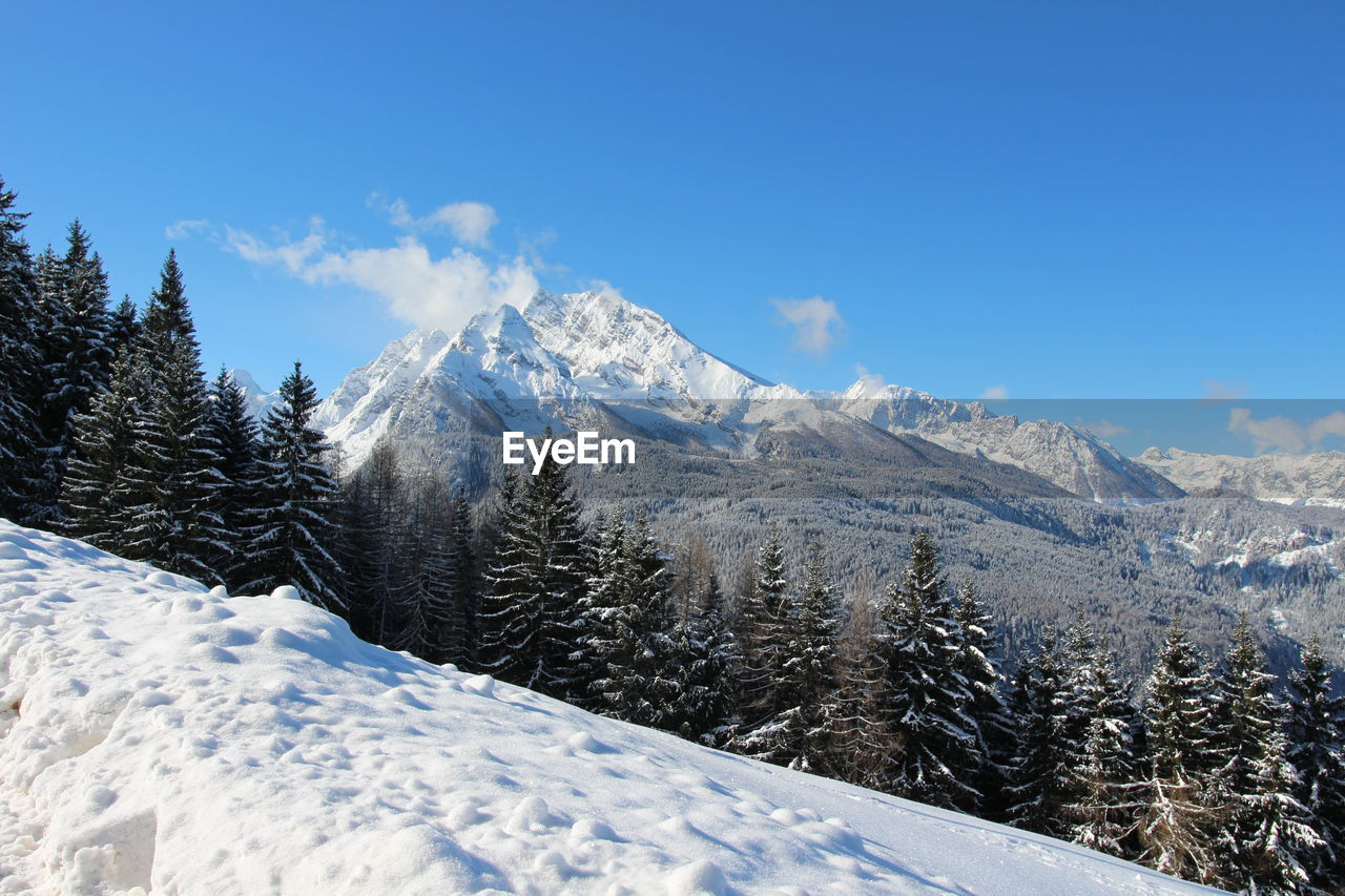 winter, cold temperature, snow, mountain, scenics - nature, sky, beauty in nature, nature, tree, tranquil scene, no people, tranquility, day, white color, environment, plant, non-urban scene, snowcapped mountain, landscape, mountain peak, range