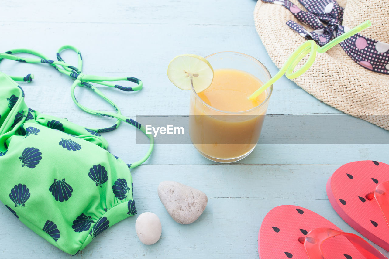 table, still life, food and drink, indoors, food, high angle view, freshness, no people, wellbeing, drink, refreshment, glass, healthy eating, close-up, egg, container, drinking glass, yellow, household equipment, multi colored