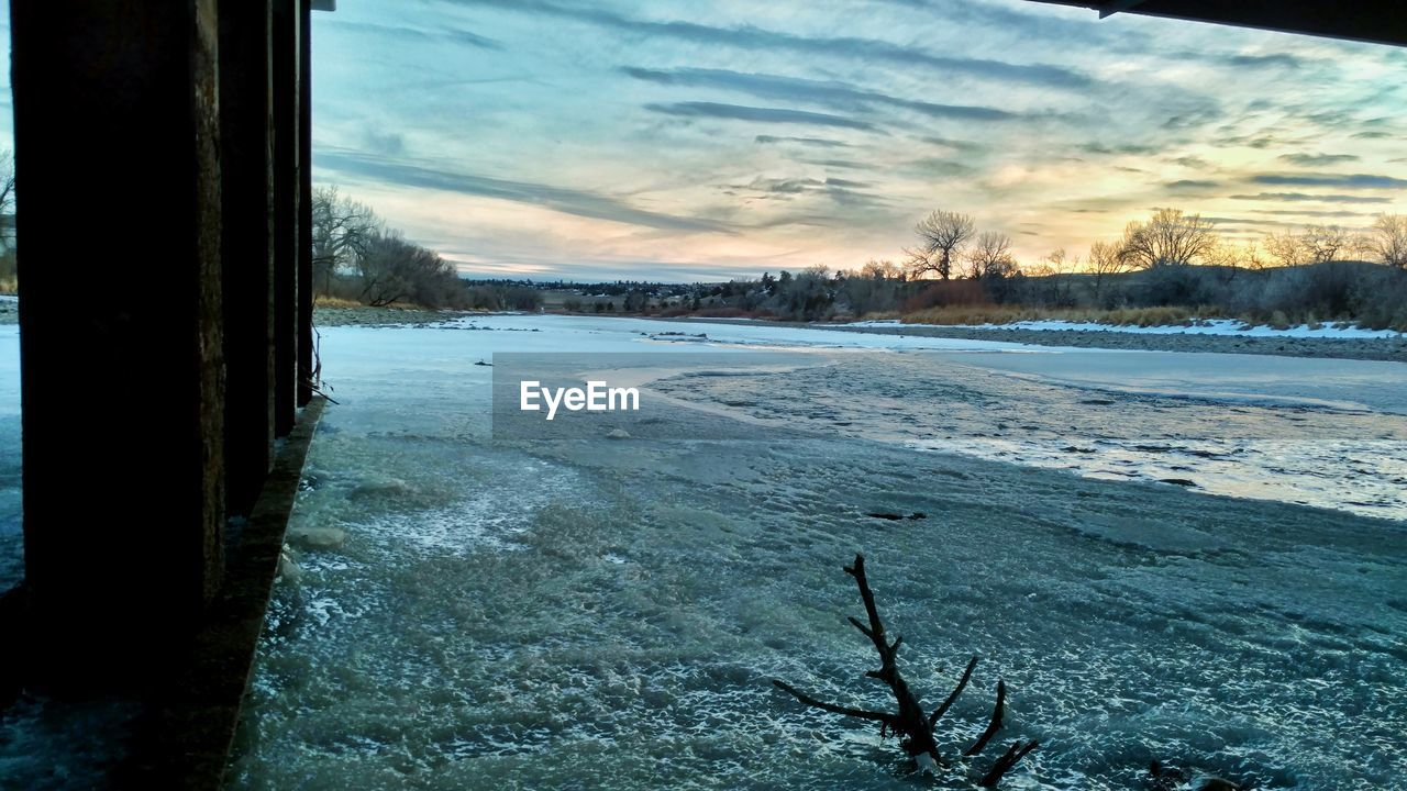 cold temperature, winter, snow, ice, nature, sky, no people, frozen, beauty in nature, outdoors, scenics, tranquil scene, lake, day, tranquility, tree, landscape, sunset
