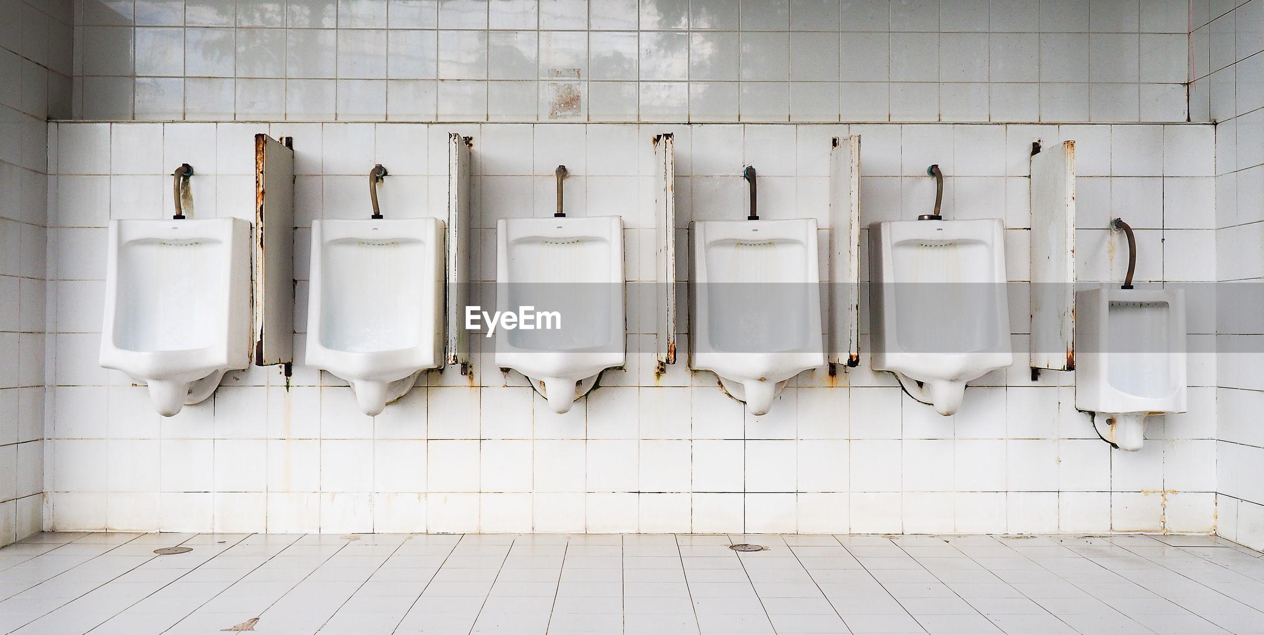White urinals in public restroom