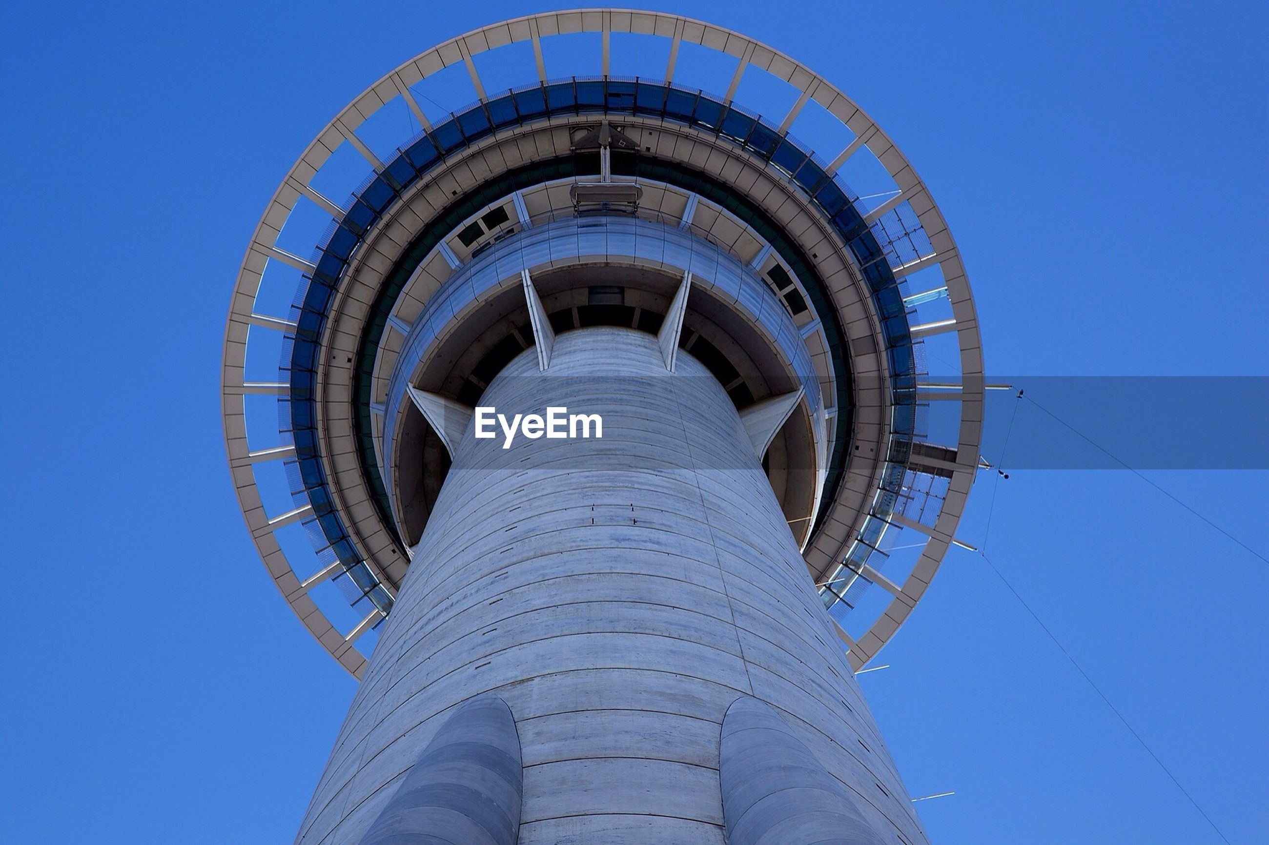 low angle view, architecture, built structure, blue, clear sky, building exterior, tower, tall - high, day, famous place, sky, arch, sunlight, travel destinations, no people, staircase, outdoors, spiral, modern, steps and staircases