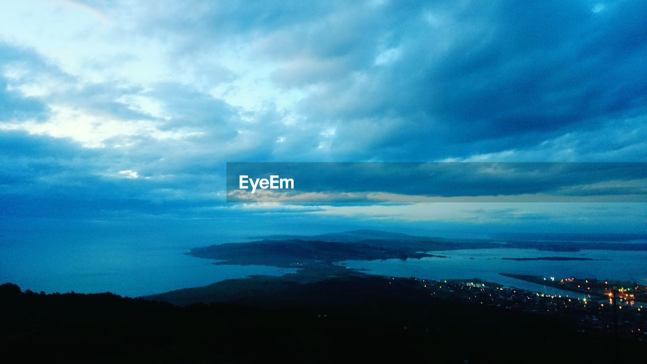 sky, cloud - sky, nature, outdoors, no people, beauty in nature, blue, building exterior, architecture, scenics, built structure, cityscape, travel destinations, mountain, city, day, sea