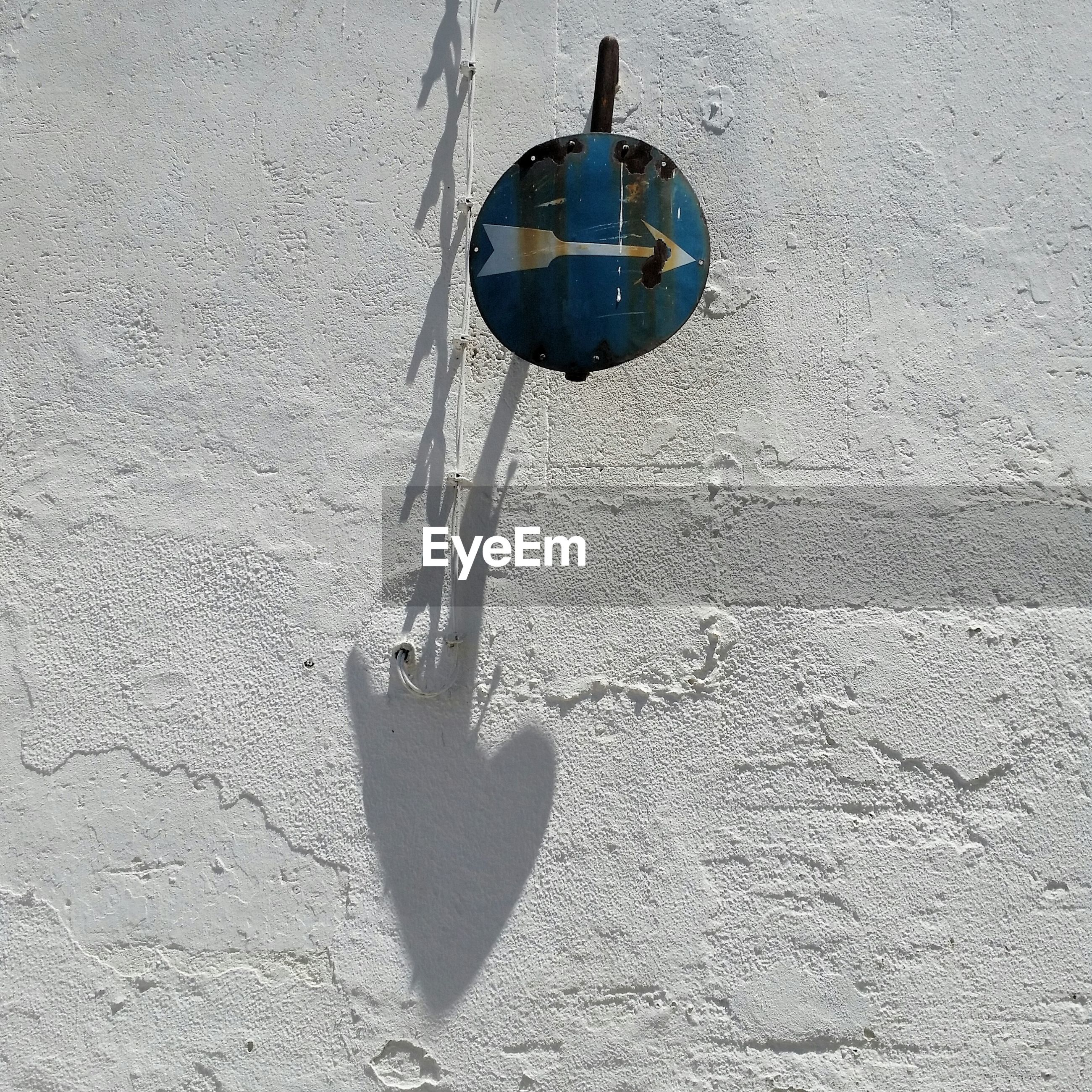 CLOSE-UP OF ELECTRIC HANGING ON WALL