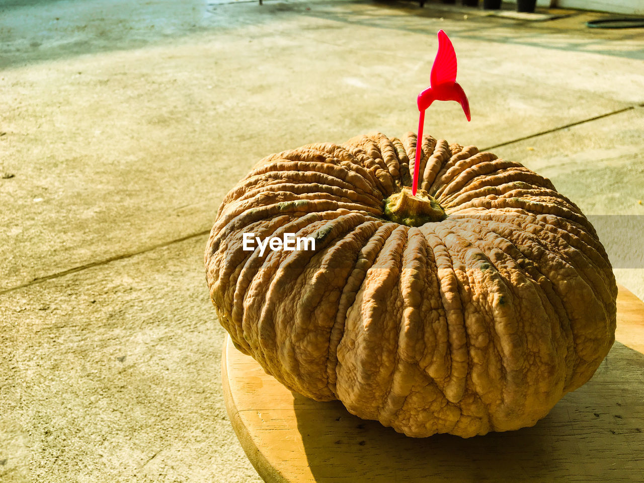 Close-up of damaged pumpkin on table