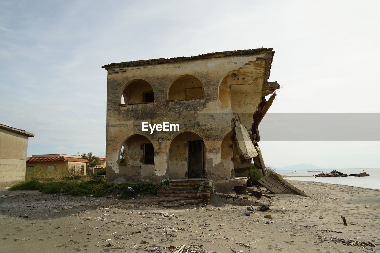 architecture, built structure, sky, history, building exterior, the past, arch, nature, land, day, building, no people, outdoors, beach, old, abandoned, water, sea, cloud - sky, sand