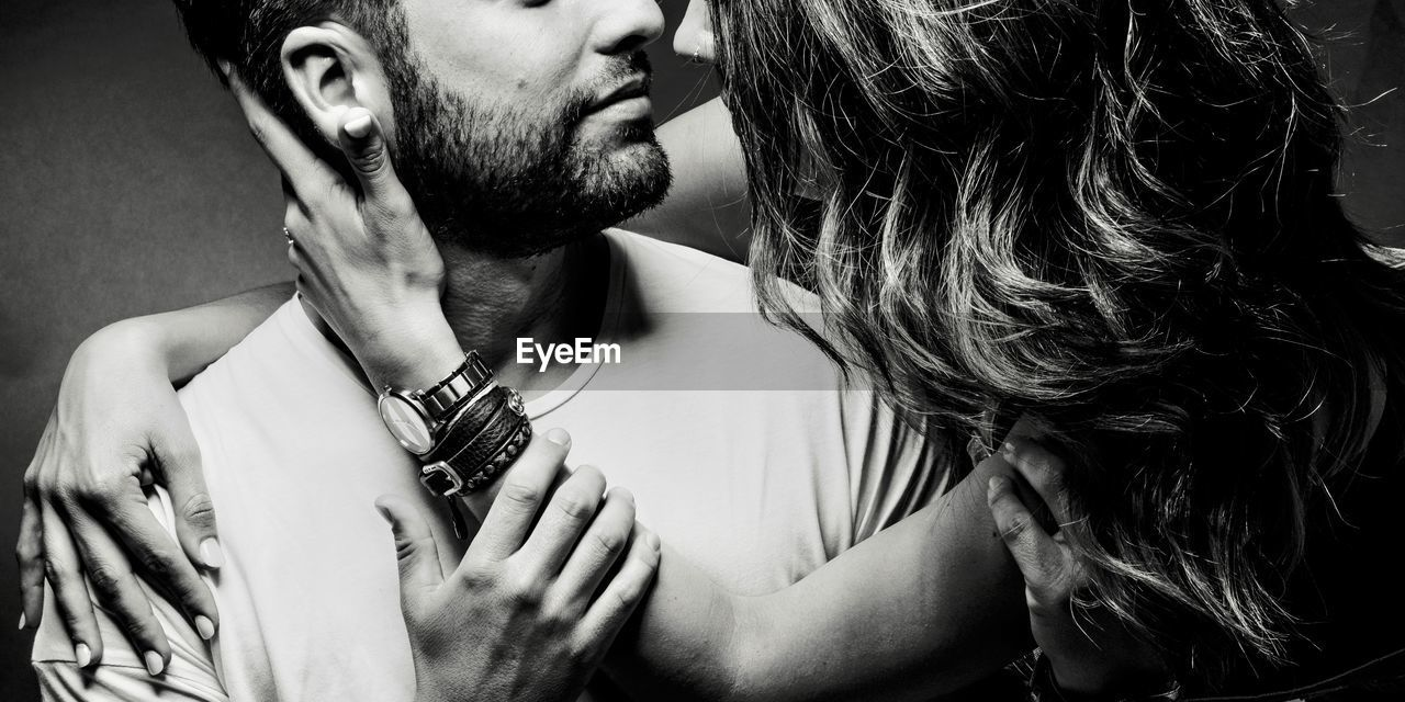 real people, two people, indoors, men, young adult, adult, love, people, beard, young men, couple - relationship, women, emotion, facial hair, headshot, leisure activity, lifestyles, young women, togetherness, tattoo, positive emotion