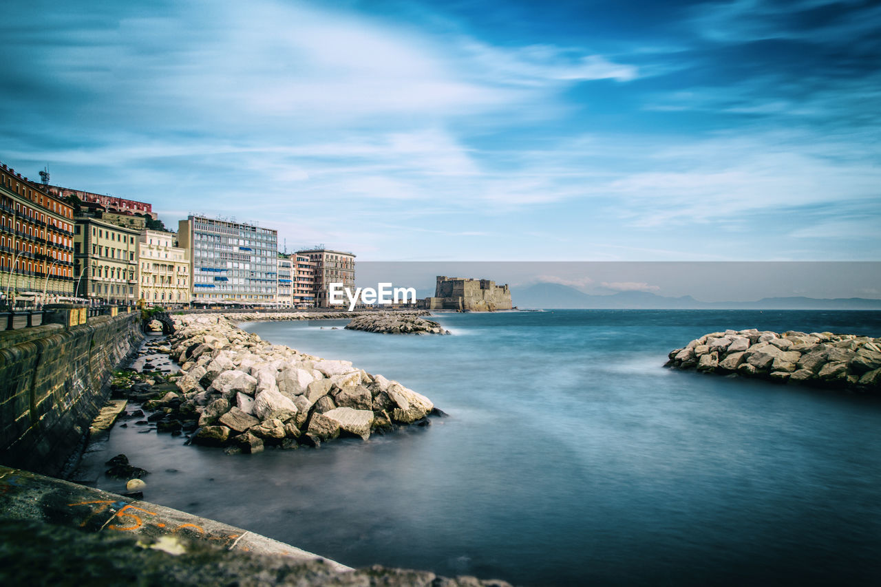 water, building exterior, architecture, built structure, sea, sky, waterfront, cloud - sky, rock, rock - object, nature, solid, building, scenics - nature, no people, beauty in nature, day, city, land, outdoors, bay