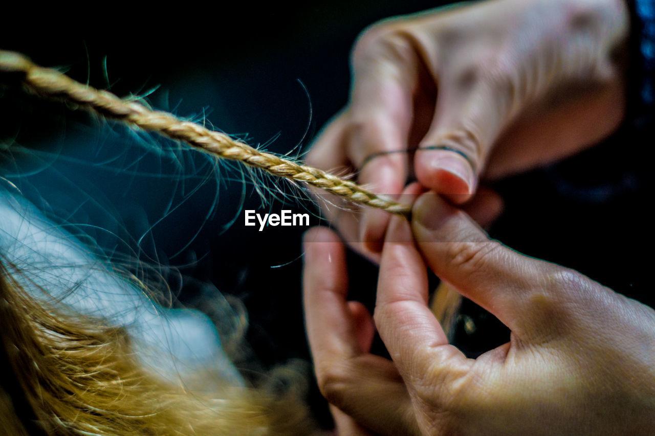 Close-Up Of Woman Braiding Hair