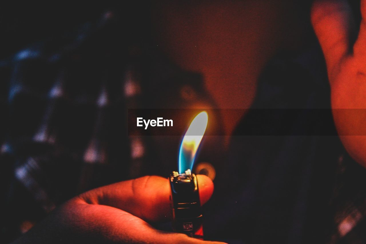 fire, flame, burning, human hand, fire - natural phenomenon, hand, real people, holding, heat - temperature, human body part, one person, close-up, illuminated, glowing, lifestyles, cigarette lighter, unrecognizable person, indoors, finger, nature, body part, dark, matchstick