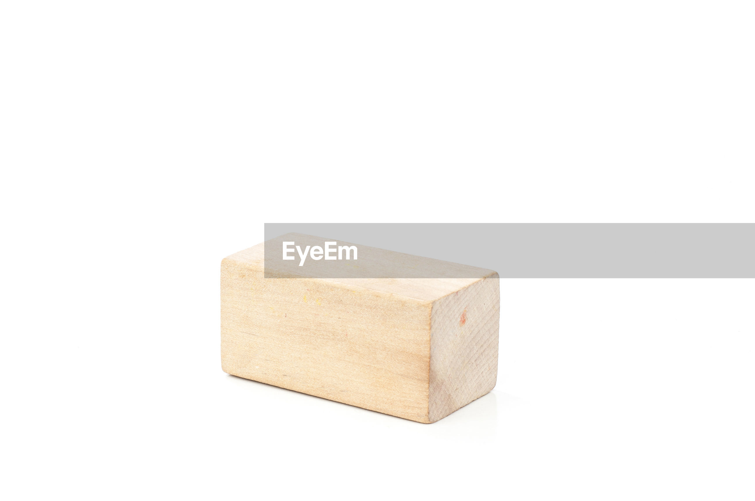 Close-up of wooden block against white background