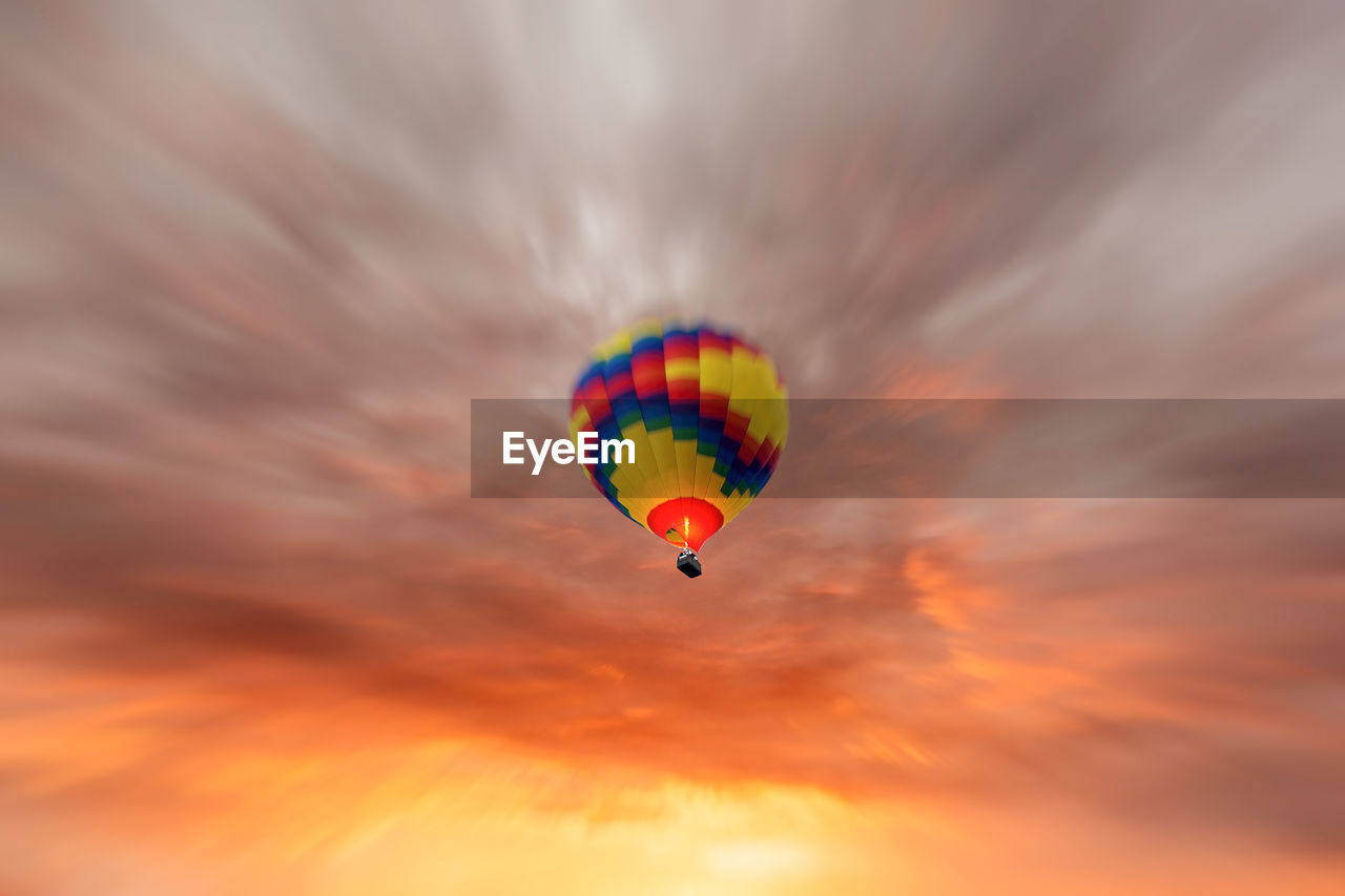sky, cloud - sky, sunset, multi colored, orange color, low angle view, flying, mid-air, hot air balloon, balloon, adventure, air vehicle, nature, transportation, beauty in nature, extreme sports, sport, freedom, scenics - nature, leisure activity, no people