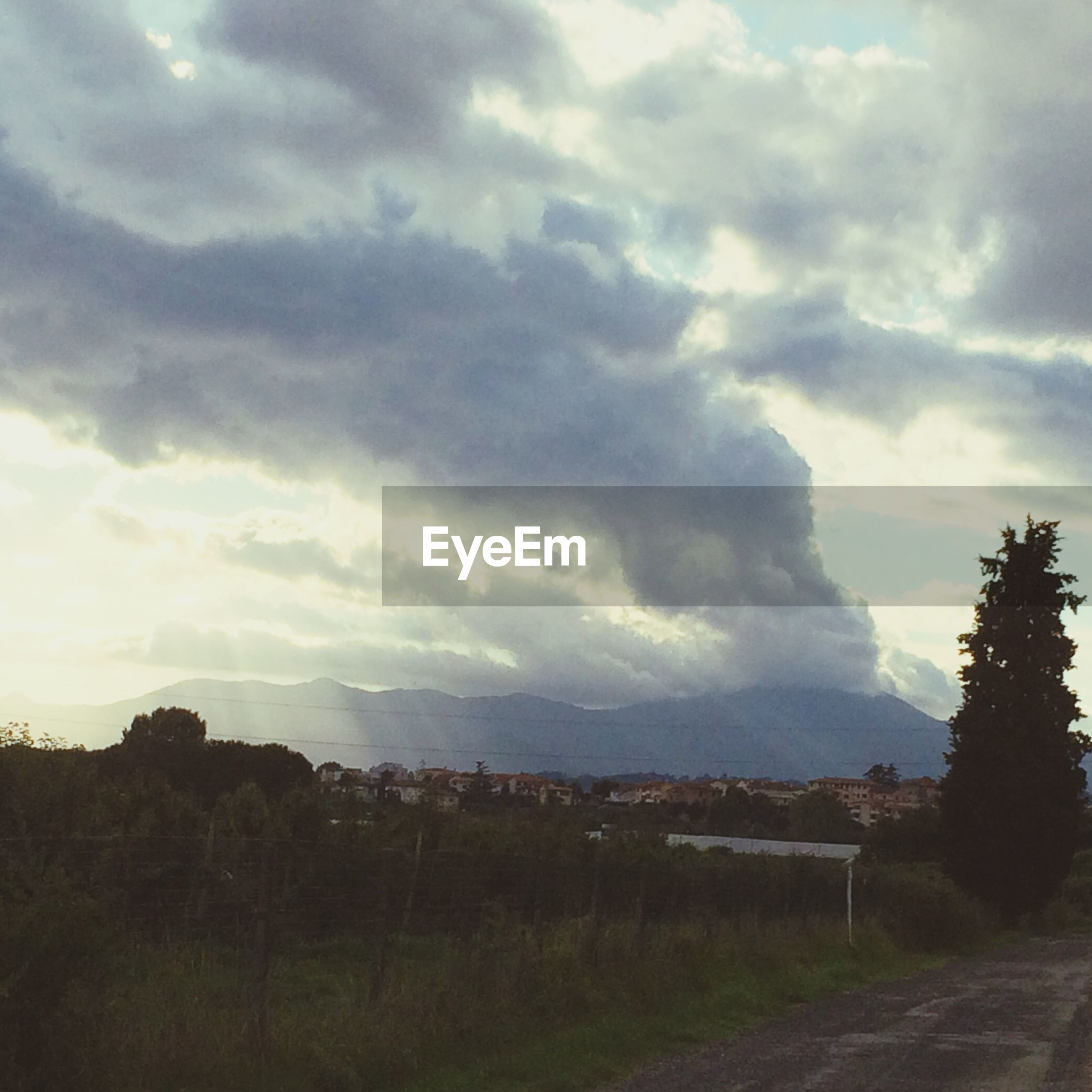 sky, cloud - sky, cloudy, landscape, tranquil scene, tranquility, field, scenics, cloud, nature, beauty in nature, grass, tree, weather, overcast, road, non-urban scene, rural scene, storm cloud, idyllic