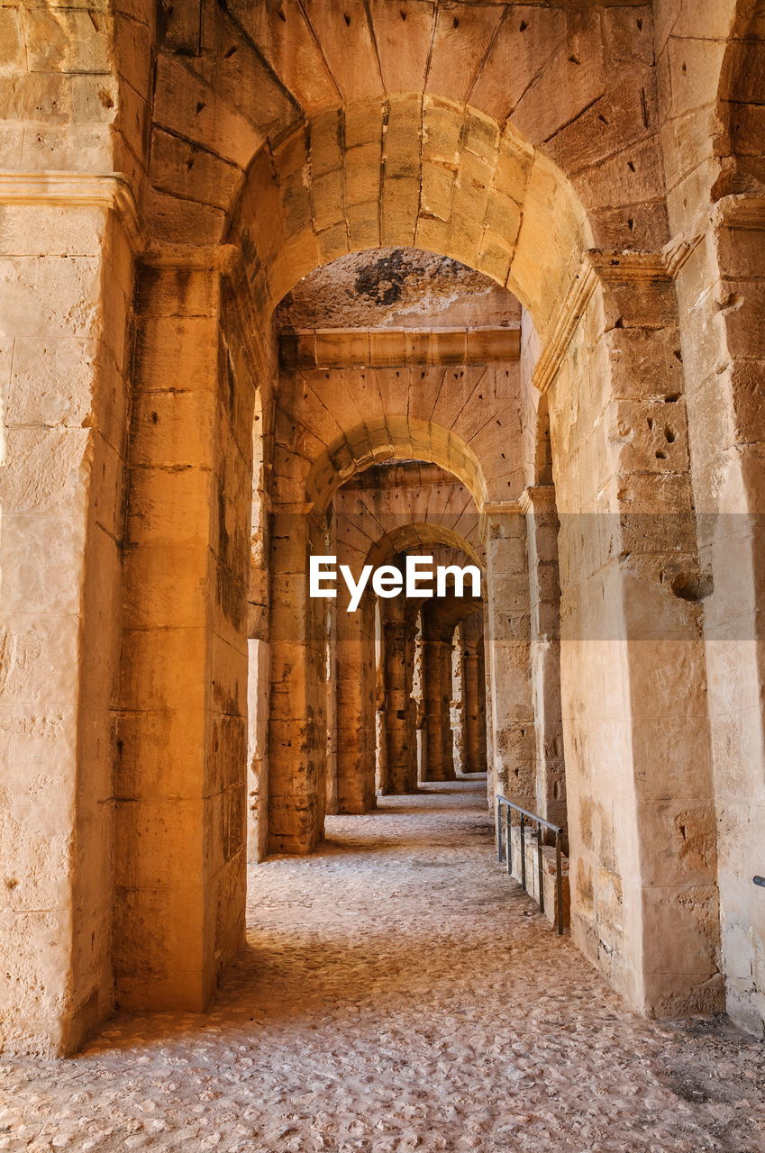 architecture, the past, history, arch, travel destinations, arcade, built structure, building, ancient, no people, corridor, architectural column, old, direction, stone material, solid, indoors, day, the way forward, ancient civilization, archaeology, colonnade, gothic style, ornate