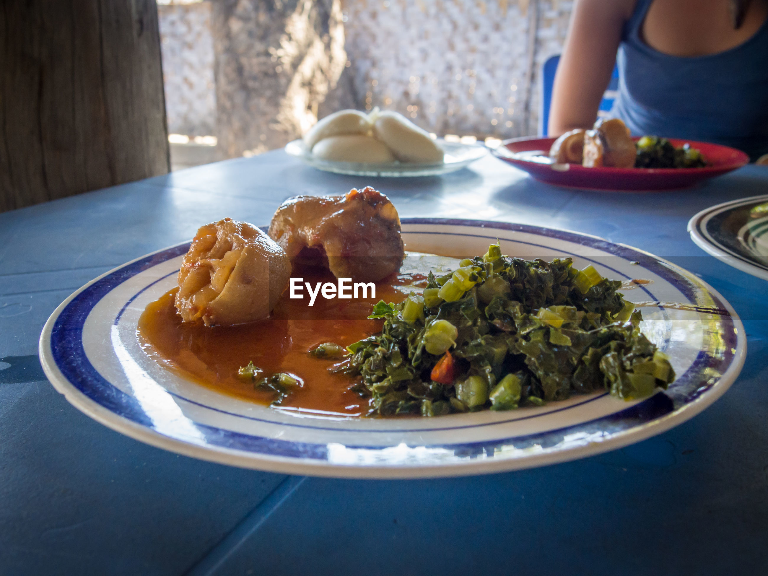 Close-up of local food in plate on table, zambia