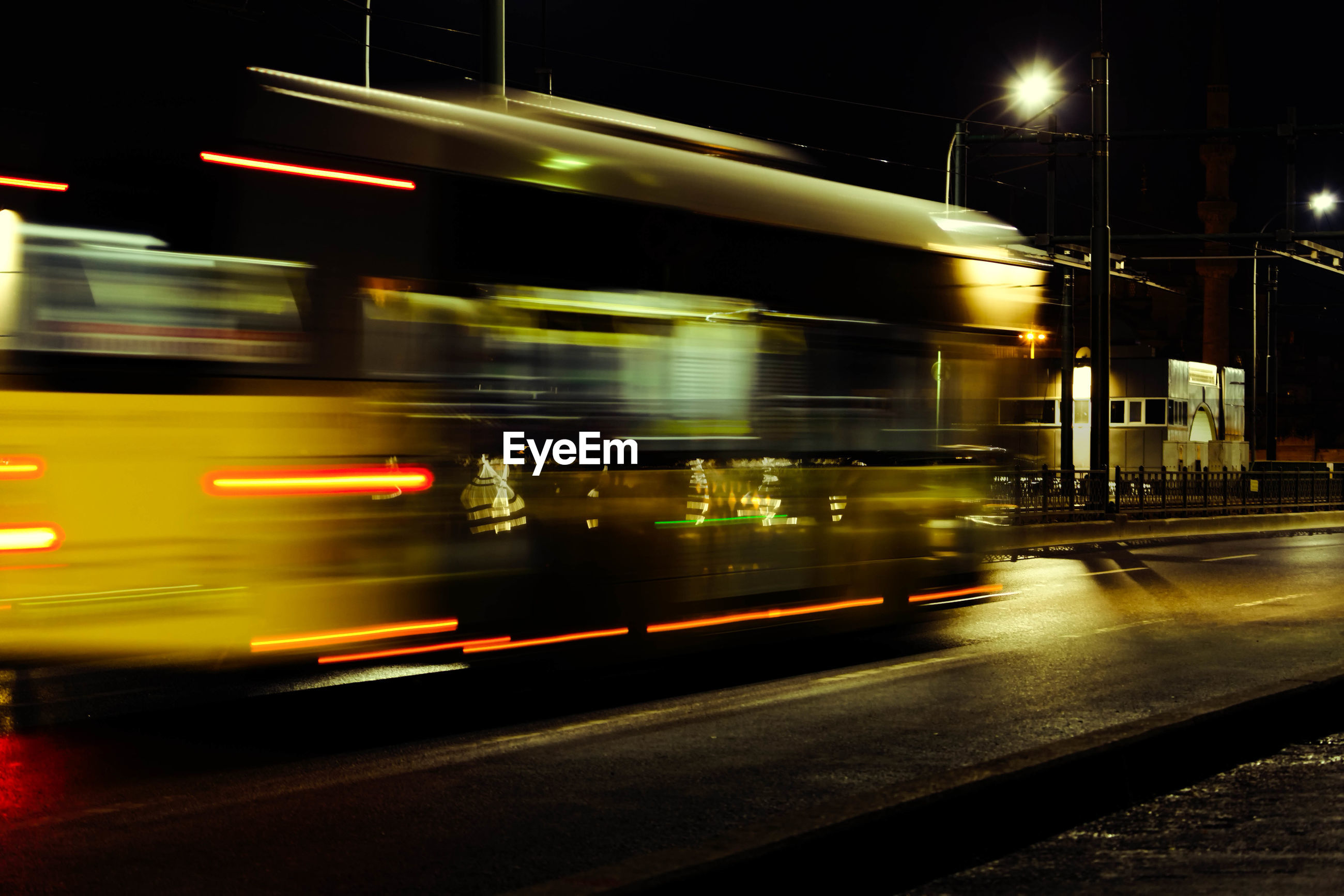 BLURRED MOTION OF CARS ON ROAD AT NIGHT