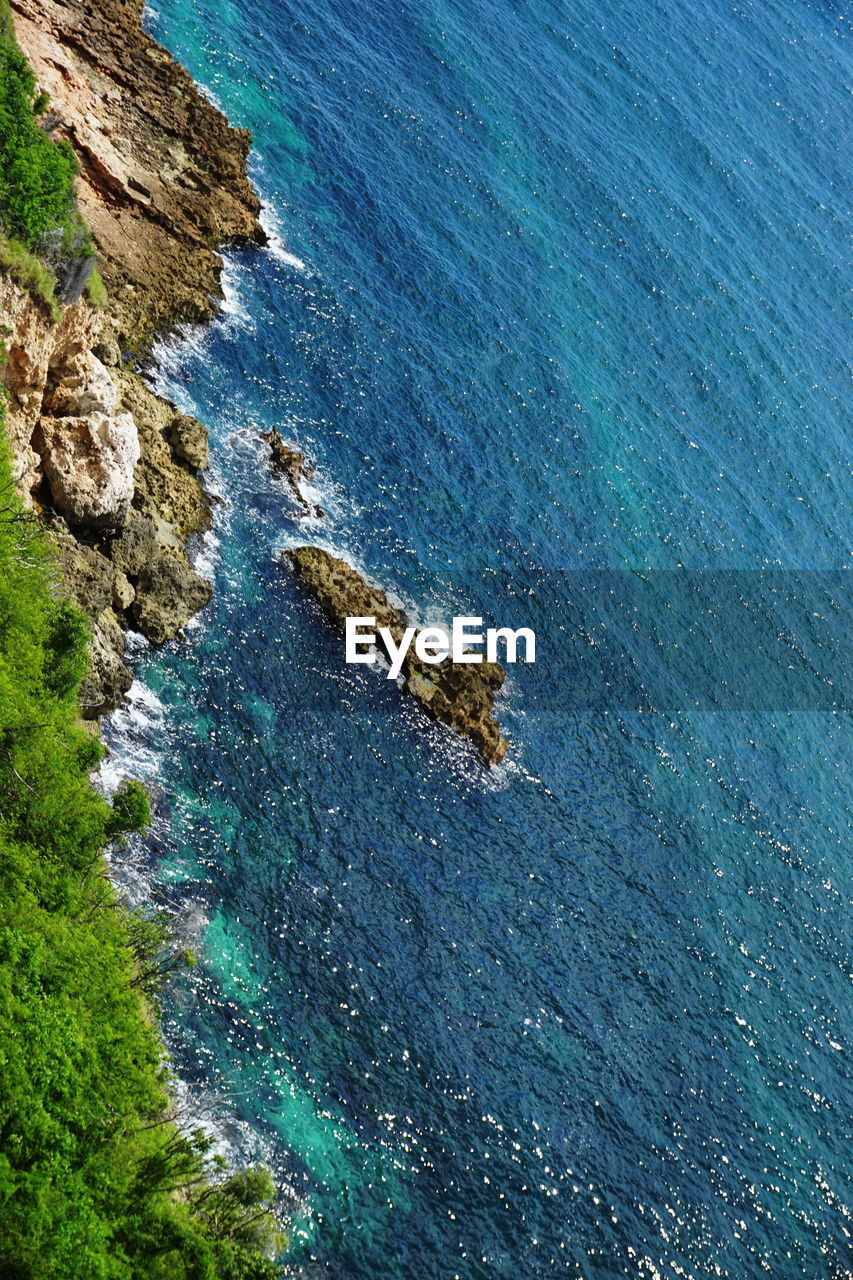 sea, water, beauty in nature, high angle view, scenics - nature, tranquil scene, tranquility, land, blue, no people, nature, rock, day, plant, idyllic, rock - object, outdoors, solid, rock formation, turquoise colored, rocky coastline
