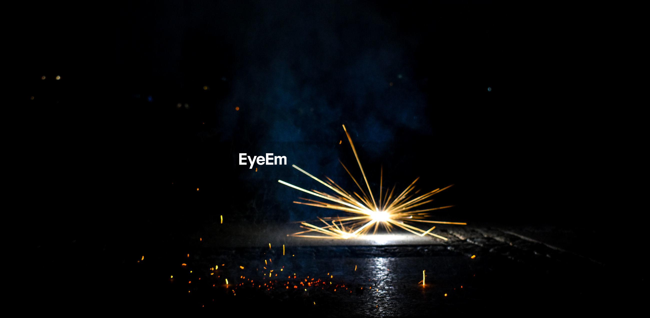 illuminated, firework, night, glowing, celebration, long exposure, motion, firework display, event, firework - man made object, exploding, sparks, arts culture and entertainment, blurred motion, nature, light, sky, no people, burning, reflection, dark, outdoors, sparkler, electric lamp
