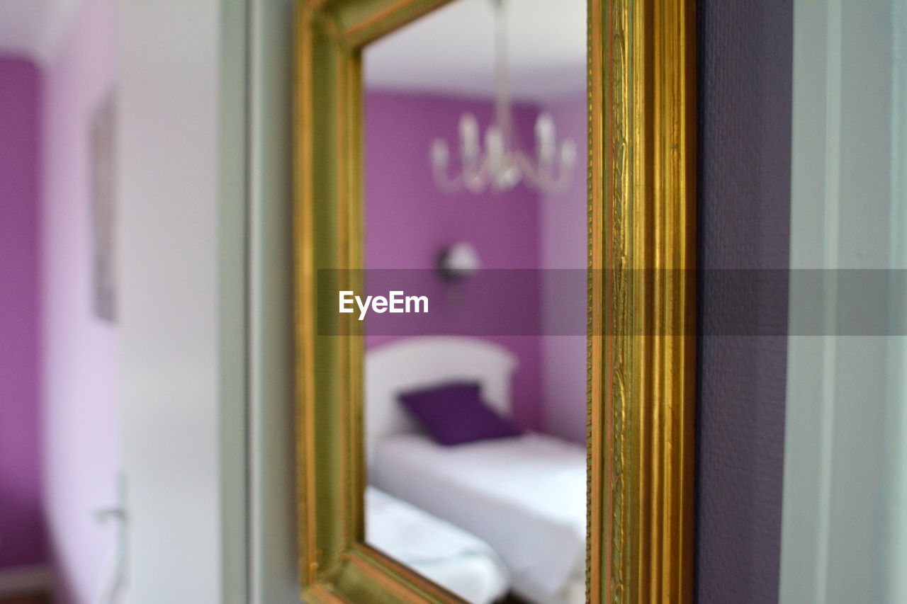 Reflection Of Bed On Mirror At Home